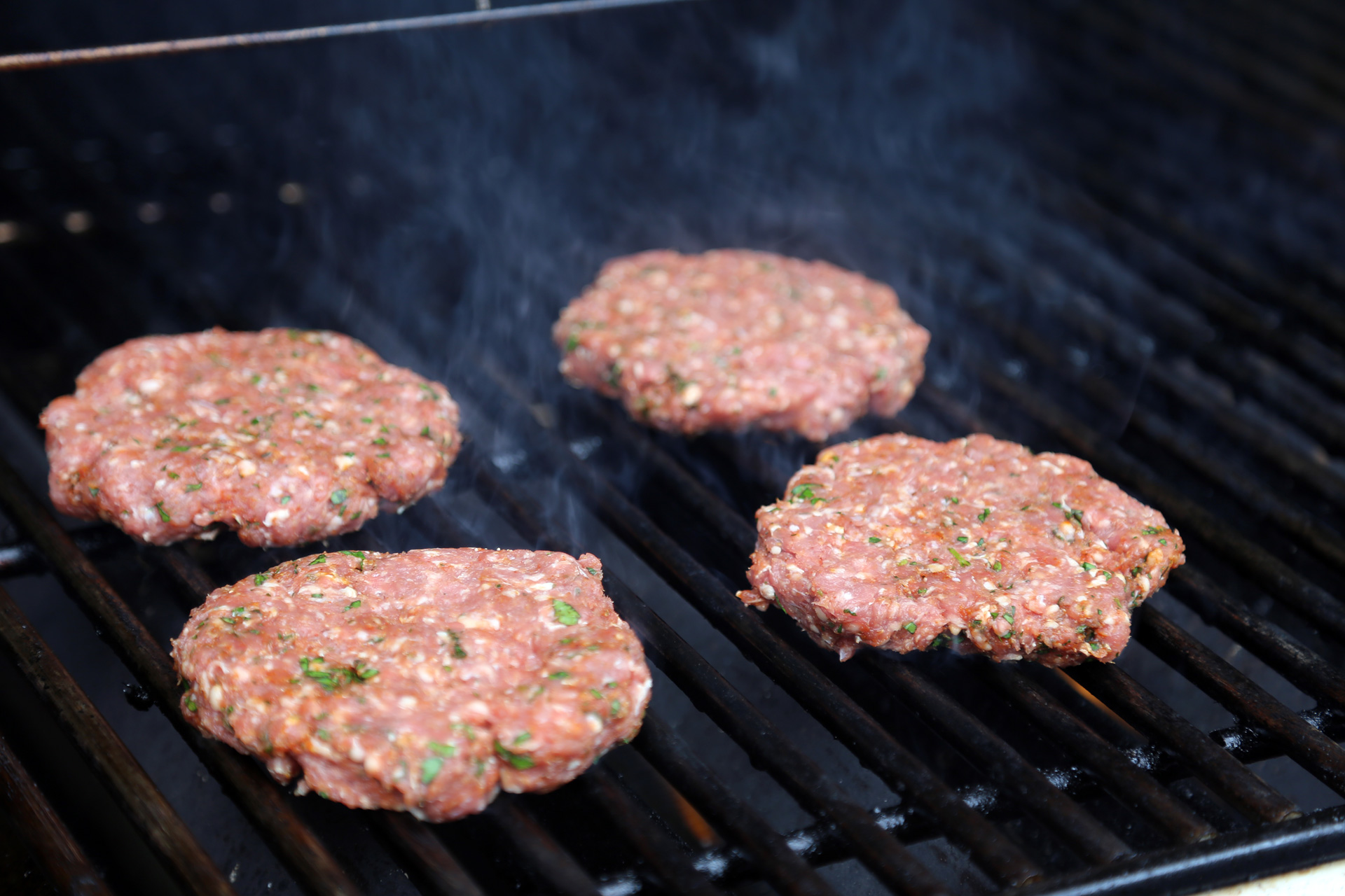 Grill the patties over the fire.