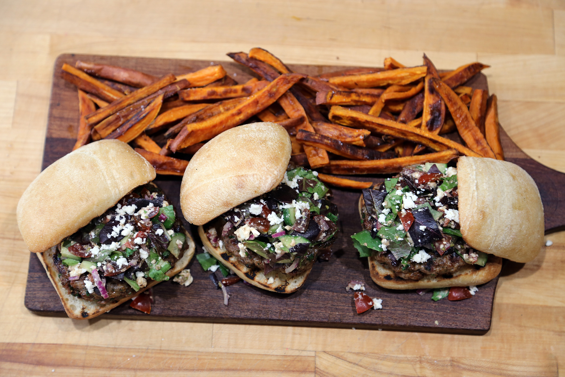 Baked Sweet Potato Fries are a perfect accompaniment to Herbed Lamb Burgers Topped with Chopped Greek Salad.