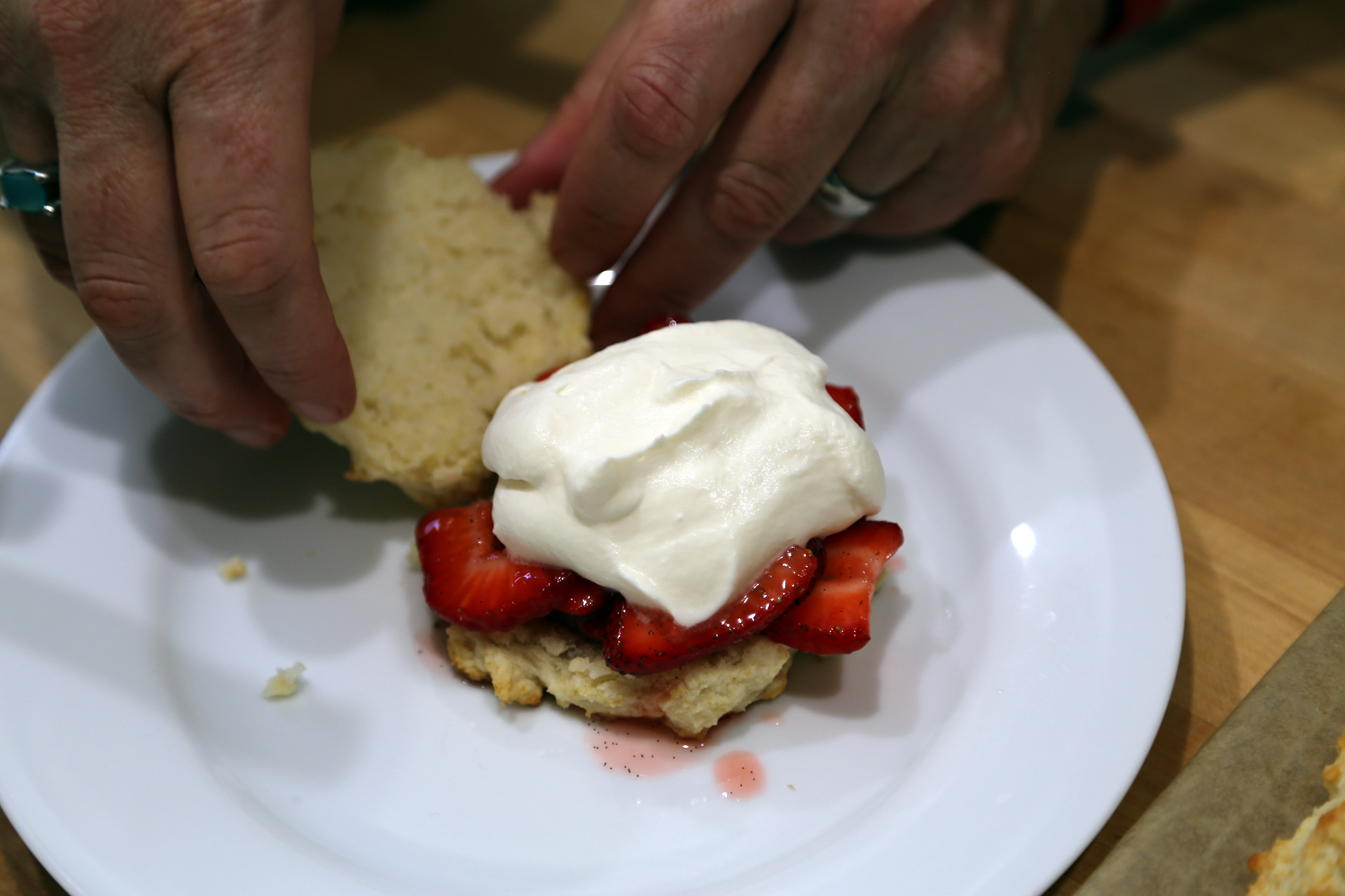 Top with a heaping spoonful of strawberries with the juices, some whipped cream.
