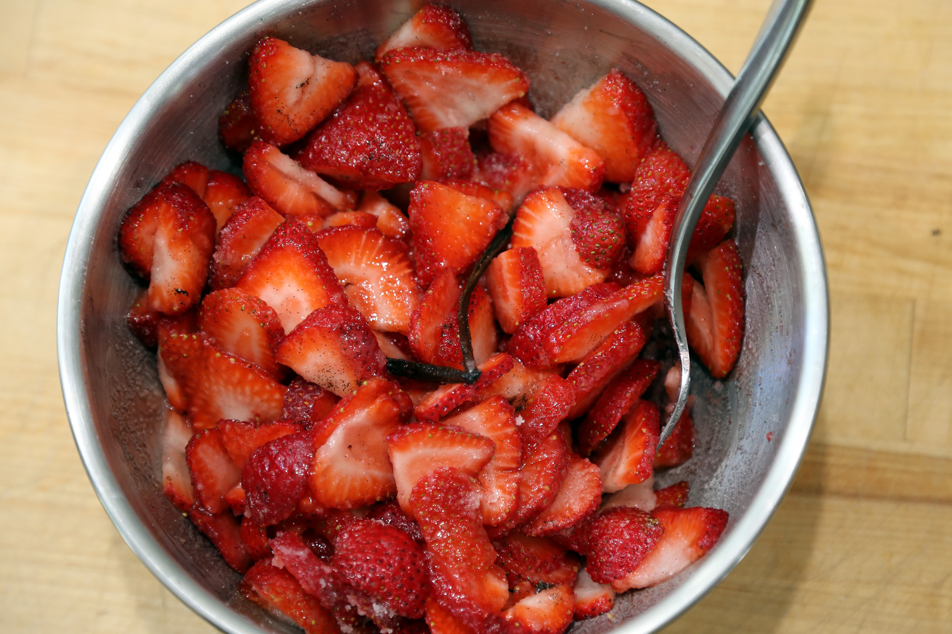 In a bowl, stir together the strawberries, 1/3 cup sugar, and vanilla bean seeds and pod.