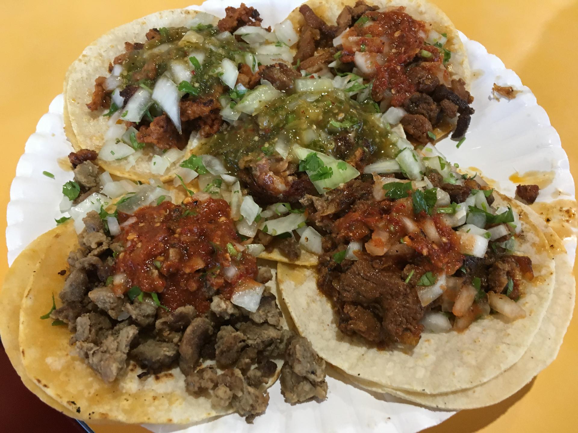 A plate of street tacos at El Grullense with carne asada, al pastor, chorizo, and carnitas.