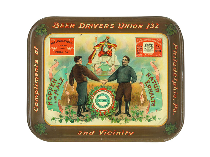 "This beer tray, circa 1905 - from the Beer Drivers Union 132 — shows a driver and a brewer working together. It says in German ""Liberty, Equality, Fraternity."""