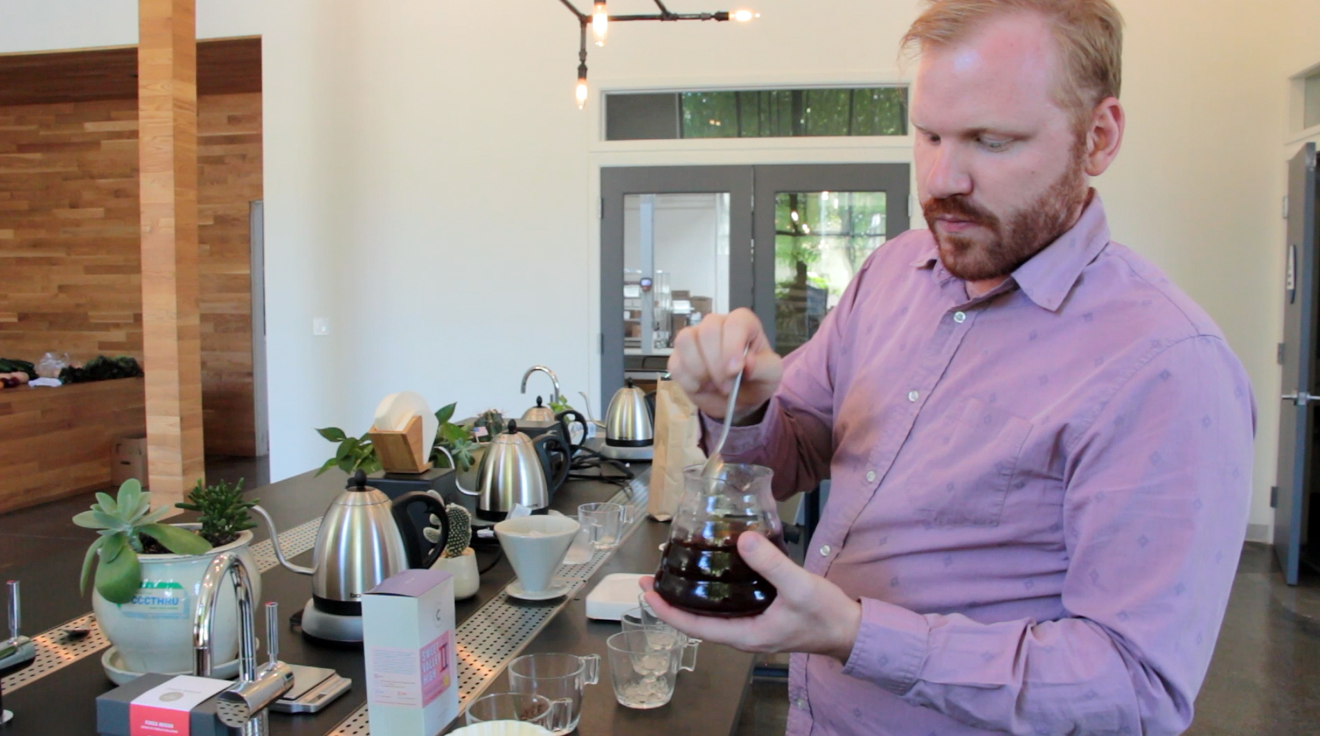 Jesse Bladyka demonstrates how to make flash brewed coffee at Counter Culture