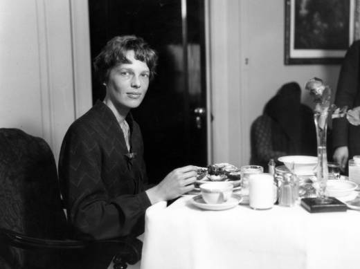 Amelia Earhart eating dinner at the Cleveland hotel. Her in-flight menu however, was usually simple, often consisting of tomato juice and a hard-boiled egg.