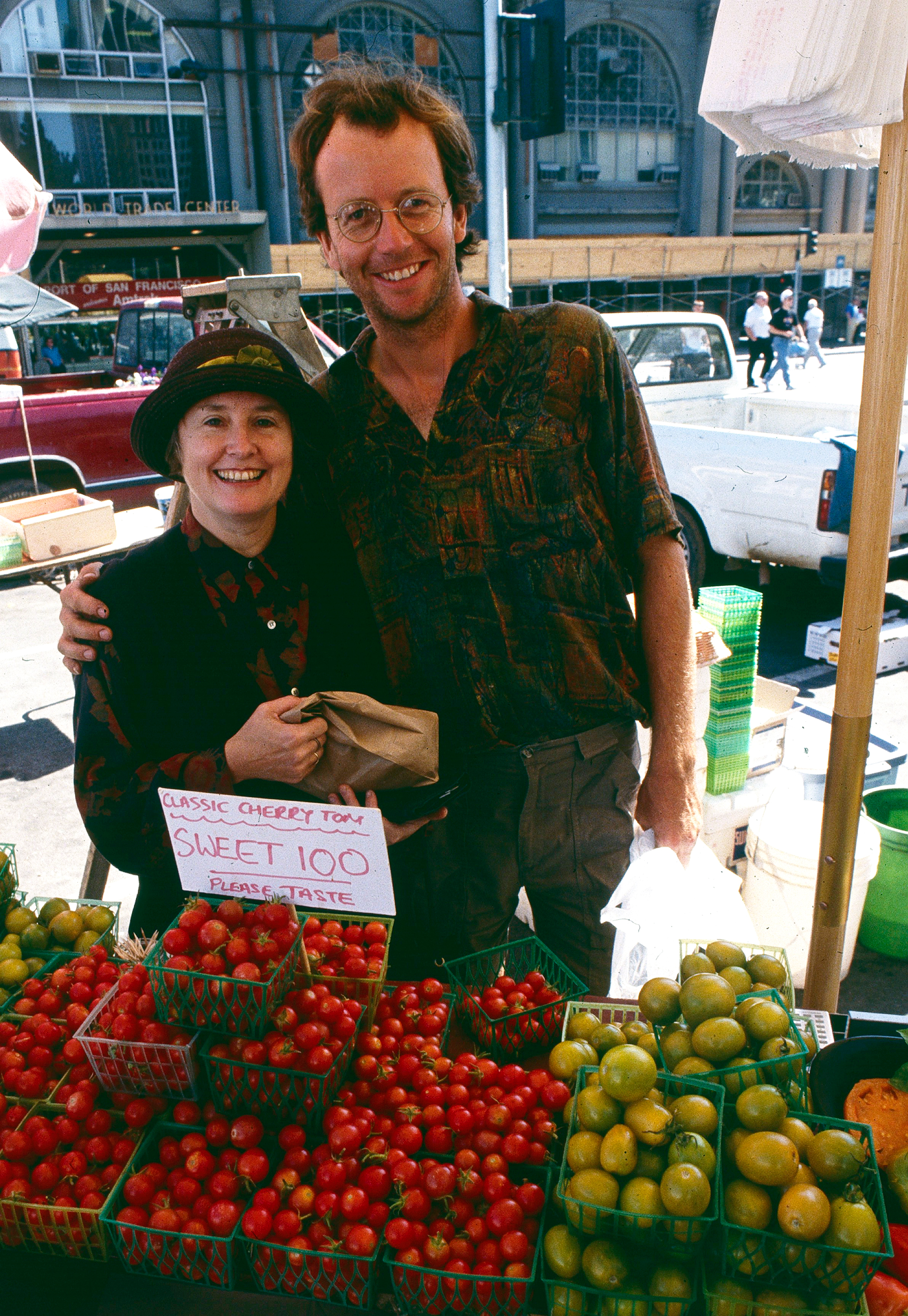 Nigel is shown in the early days of the farmer's market with Alice Waters of Chez Panisse.