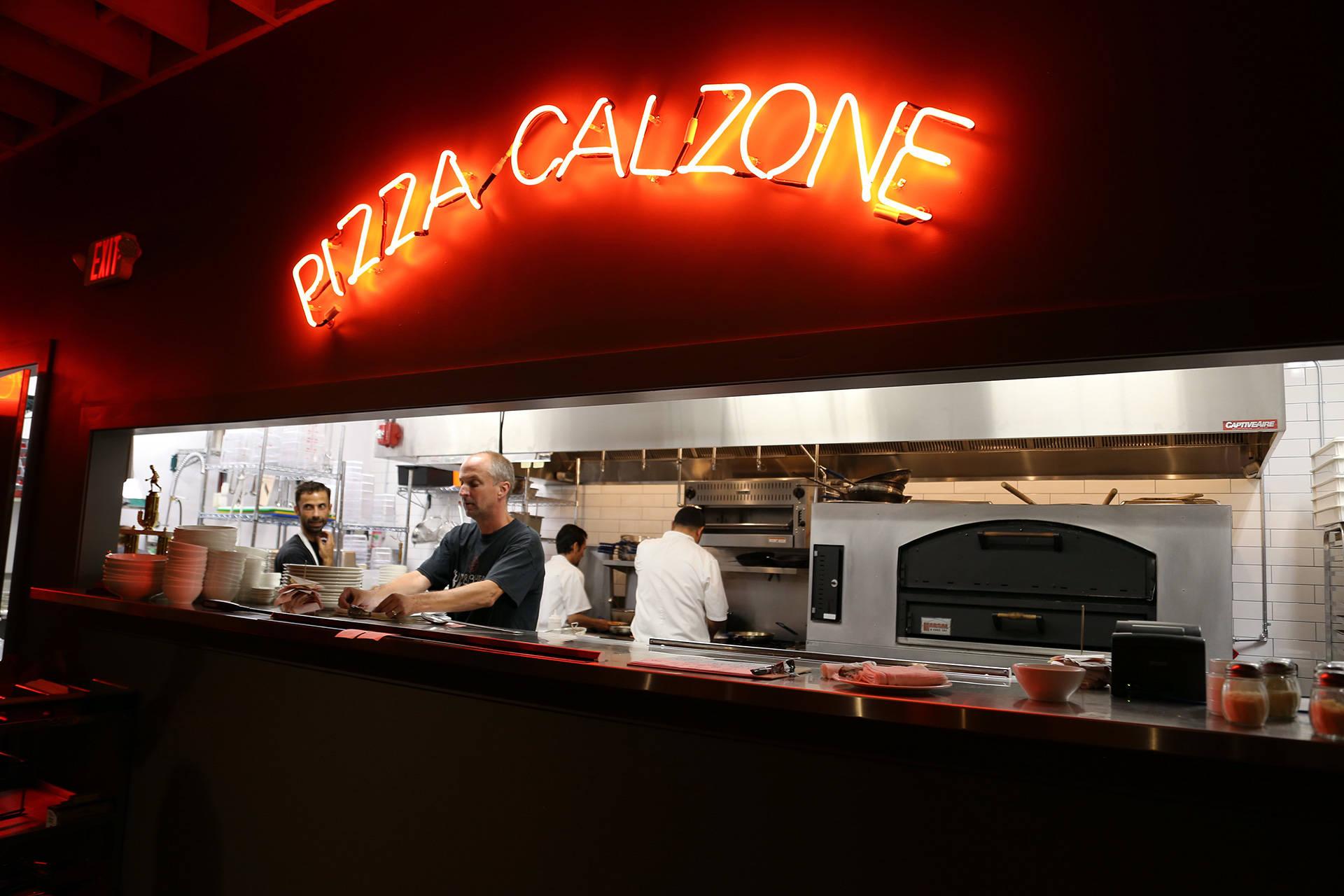 Gio's open kitchen with original Giovanni's neon signage.