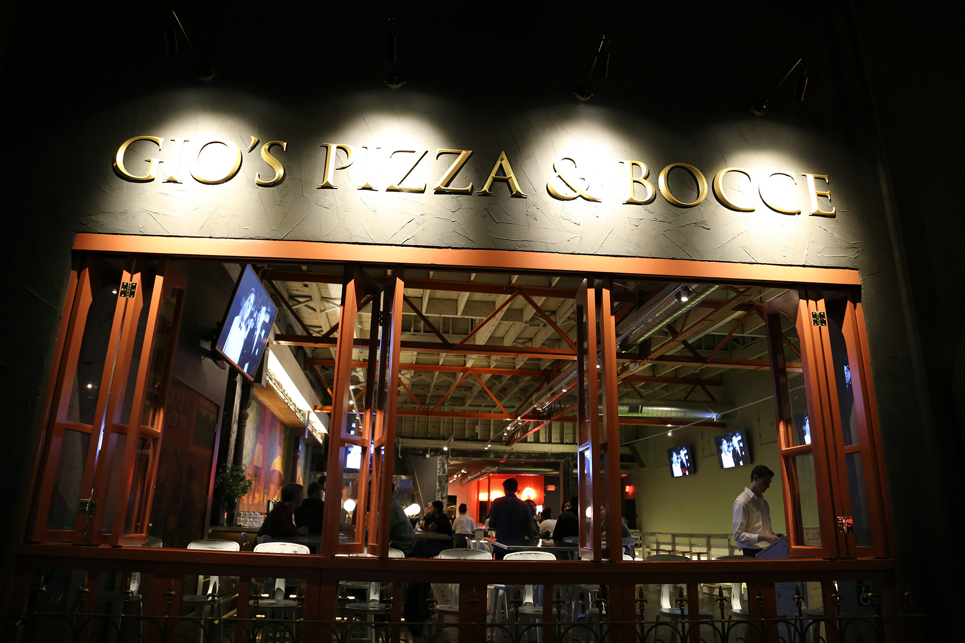 Gio's Pizza & Bocce exterior at night.