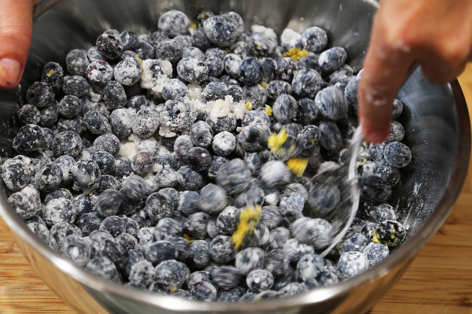 To make the filling, in a bowl, toss together the blueberries, sugar, tapioca flour, lemon zest, and lemon juice until well combined.
