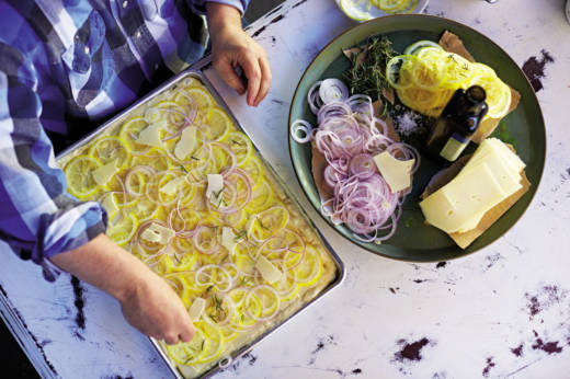 Focaccia topped with lemon pecorino and red onions is just one of the recipes featured in Bianco's new cookbook.