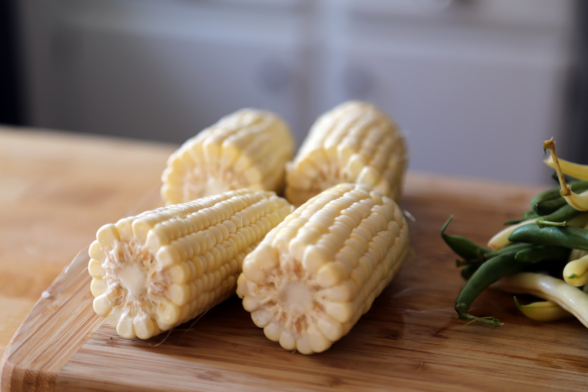 To cut the kernels off the cob, snap or cut the cob in half crosswise.