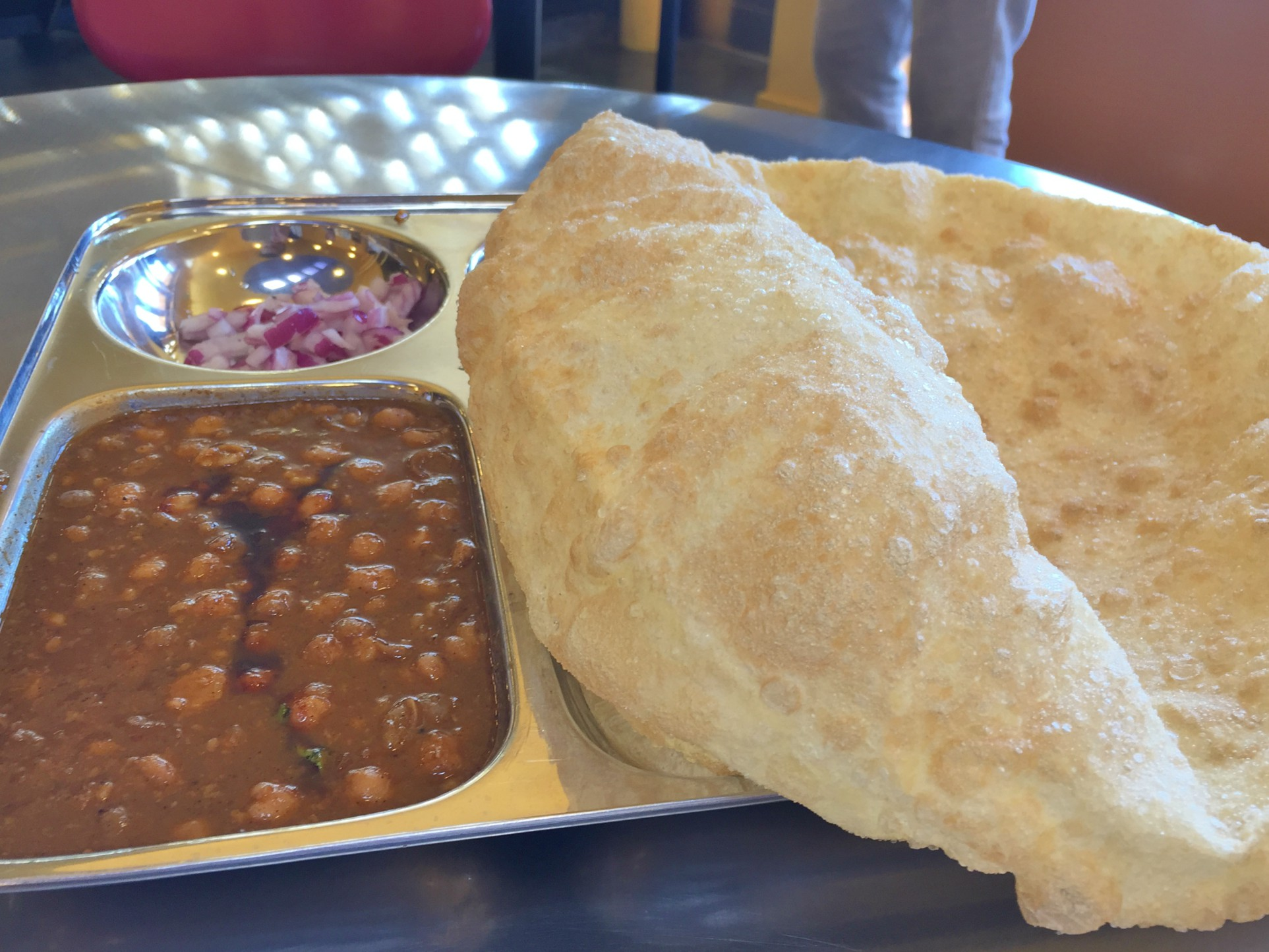 The rapidly-deflating cholle bhature makes a perfect vehicle for scooping up chana masala.