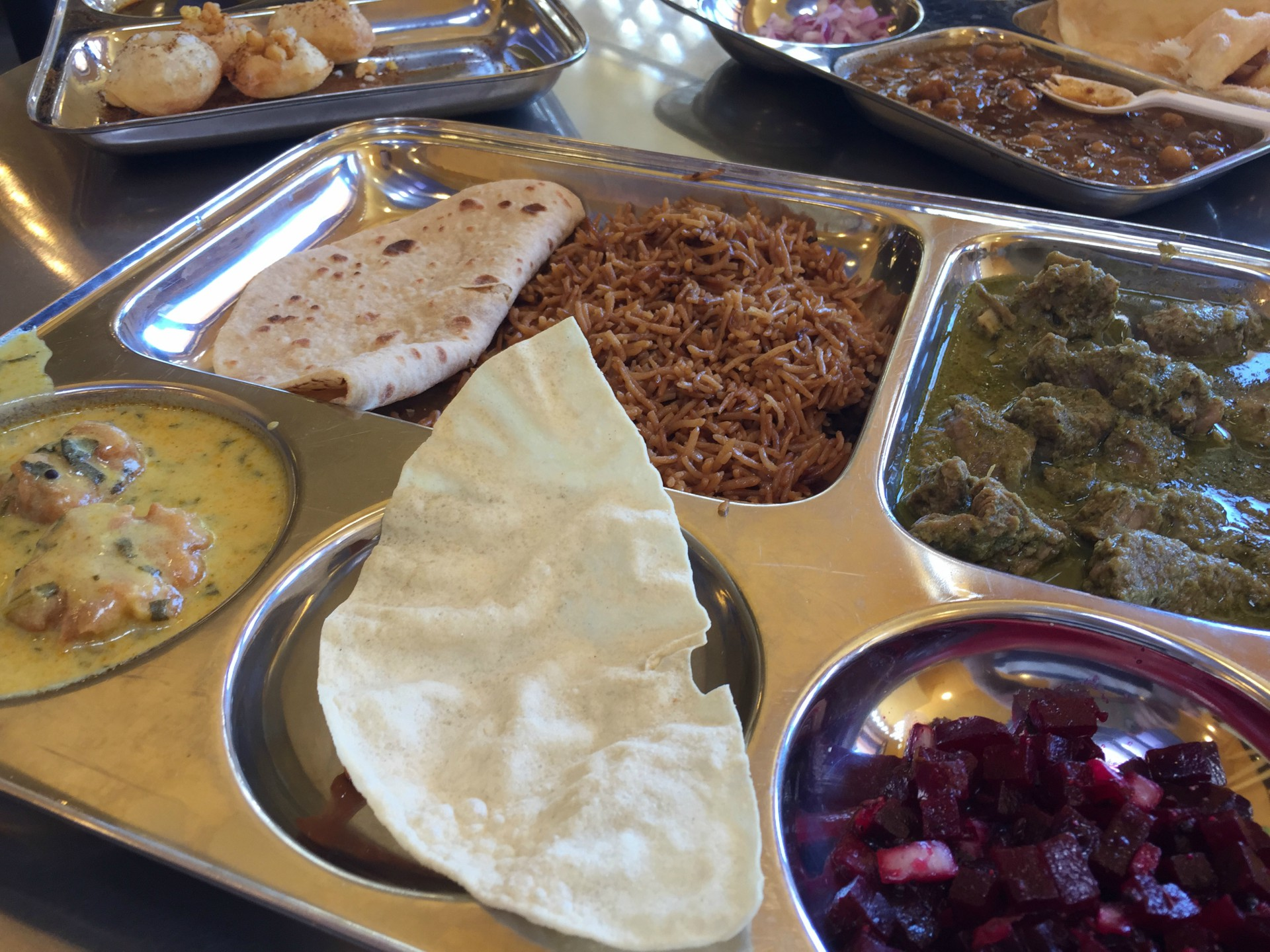 If you get the lunch special at Vik's, you'll receive a tray heavy with a variety of delicious sides.