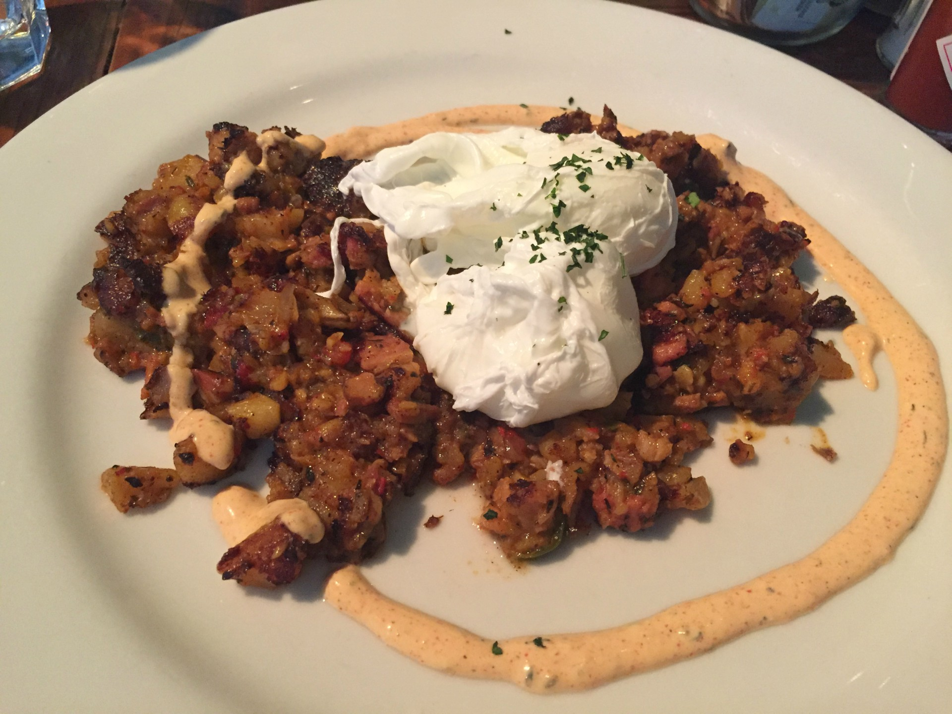 A pork hash exemplified the restaurant's zero waste policies, featuring pork leftover from making other dishes.