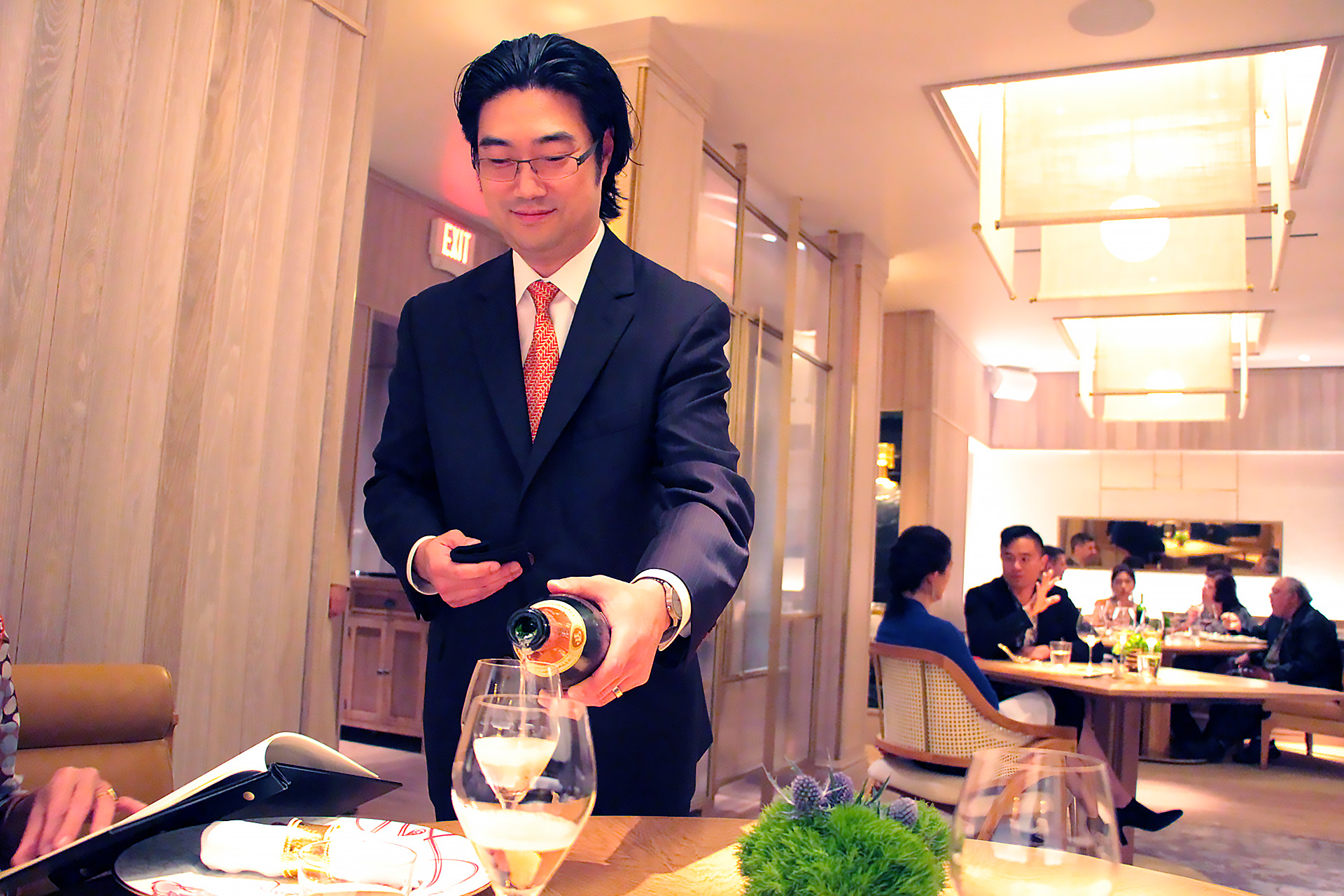 Sommelier Tony Kim pours Cuvée Angeline Brut Champagne from J. Lassalle