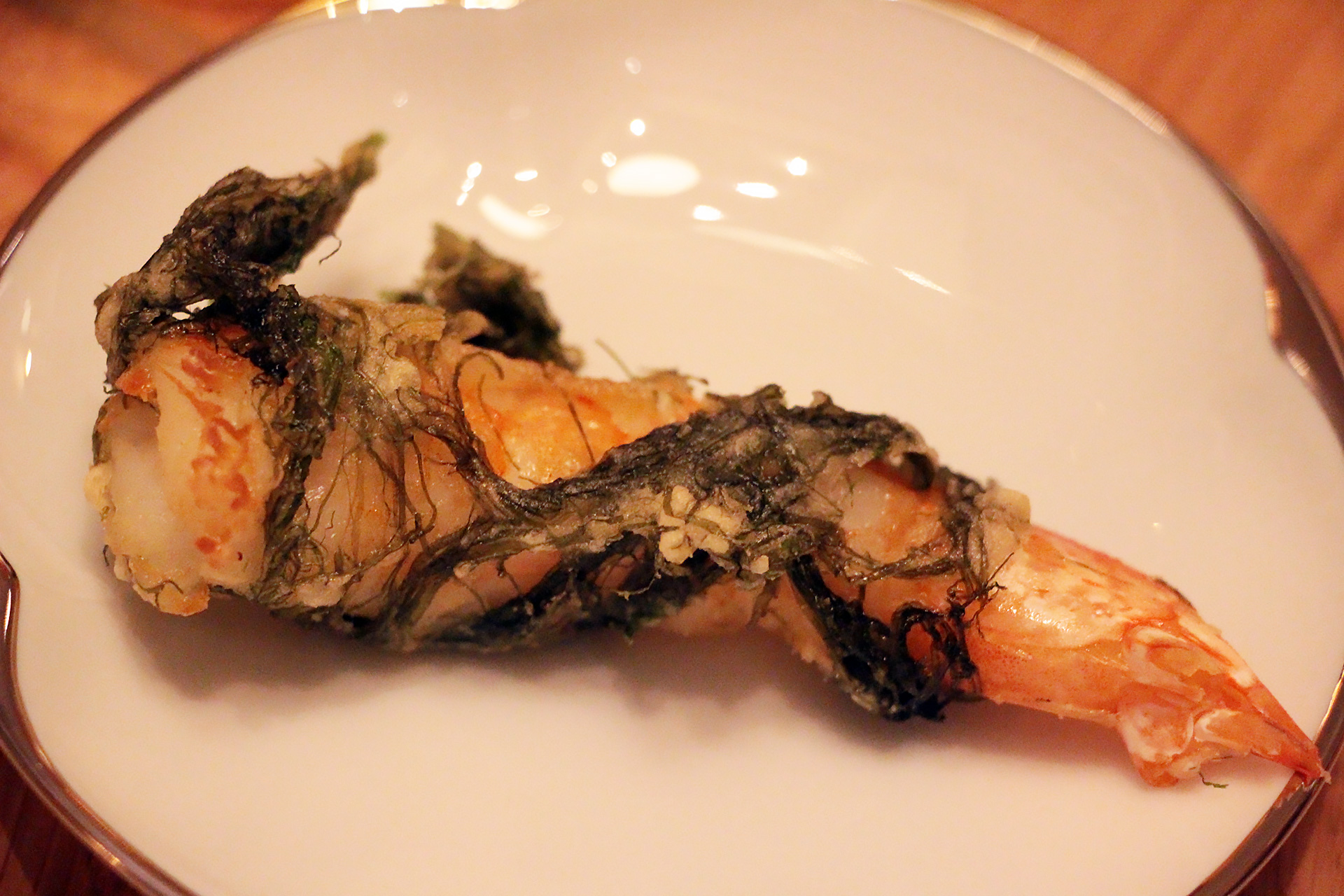 Fried shrimp wrapped in sea grass.