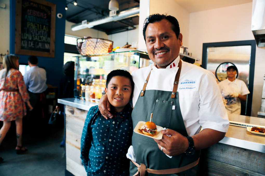 Chef/Owner Carlos Altamirano with his son showcasing a slider at the Barranco's preview party.