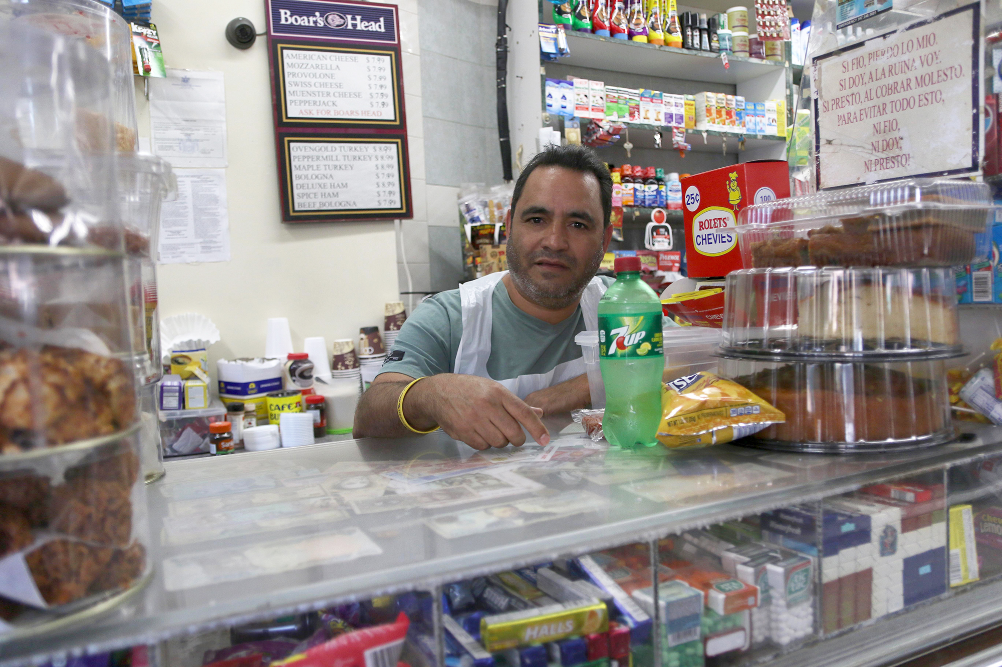 Bolivar Mena manages the Mini Market in Queens frequented by writer Angely Mercado. He always greets his customers and does his best to manage morning and afternoon rushes.