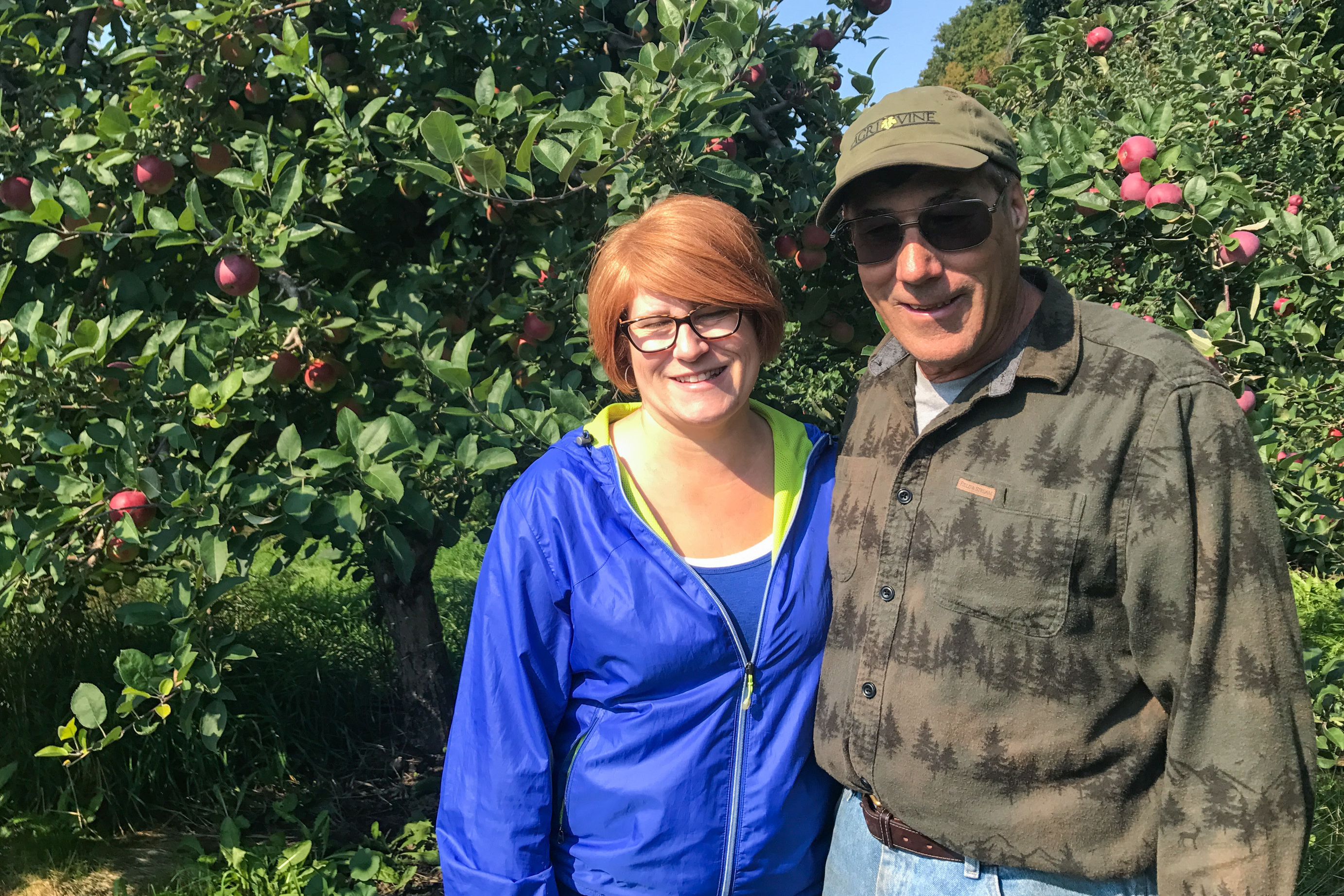 "Farm manager Heatherlyn Johnson Reamer is pictured with her father, Dean Johnson, who owns Johnson Farms. Without migrant workers to pick the crops, Reamer says, ""There wouldn't be food. It's just as simple as that."""