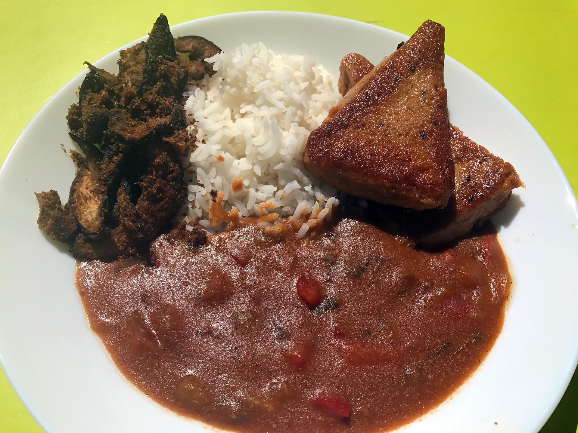 Moin moin with suya, yaji sauce and rice.