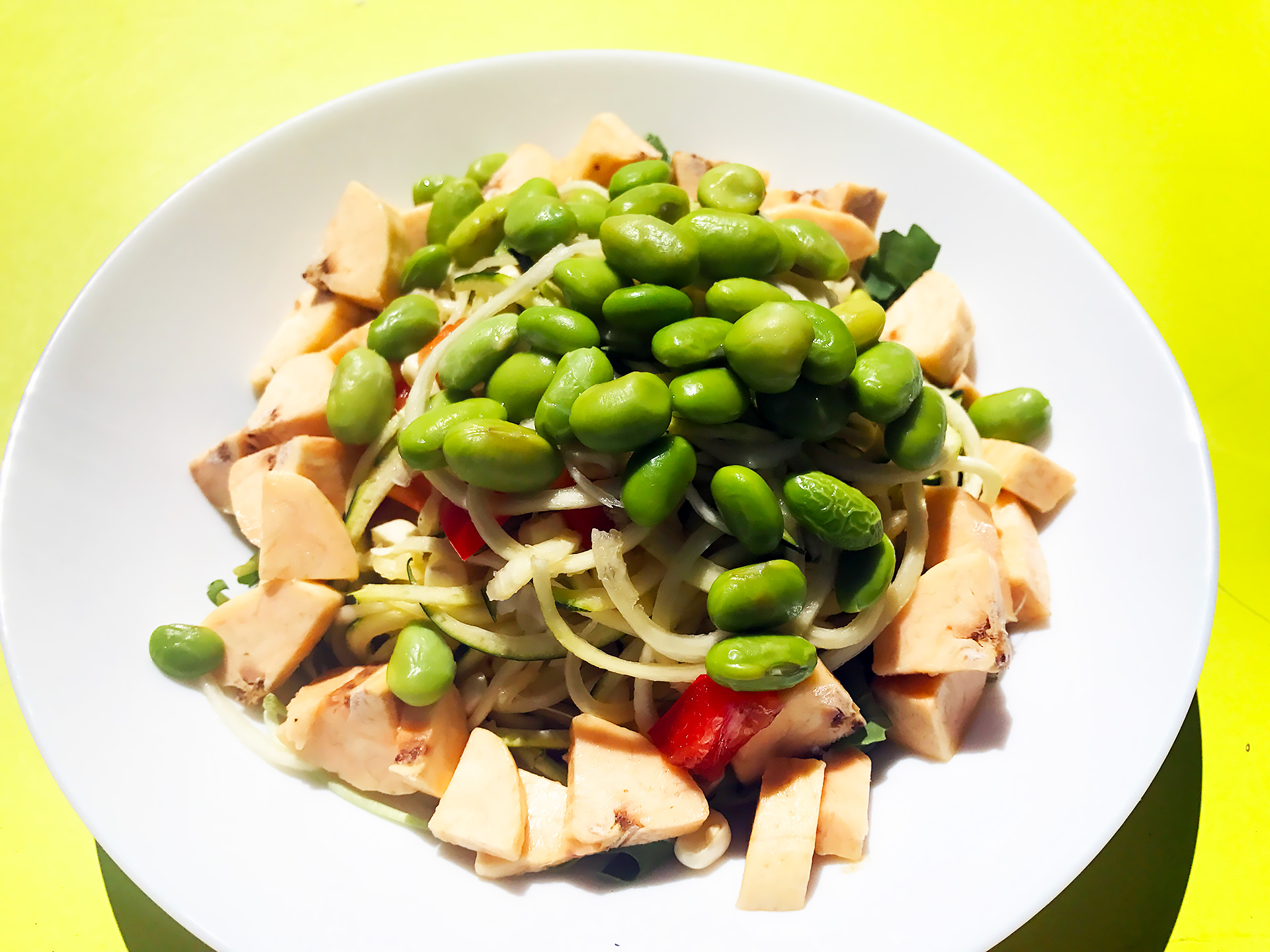 A raw plantain salad with edamame.