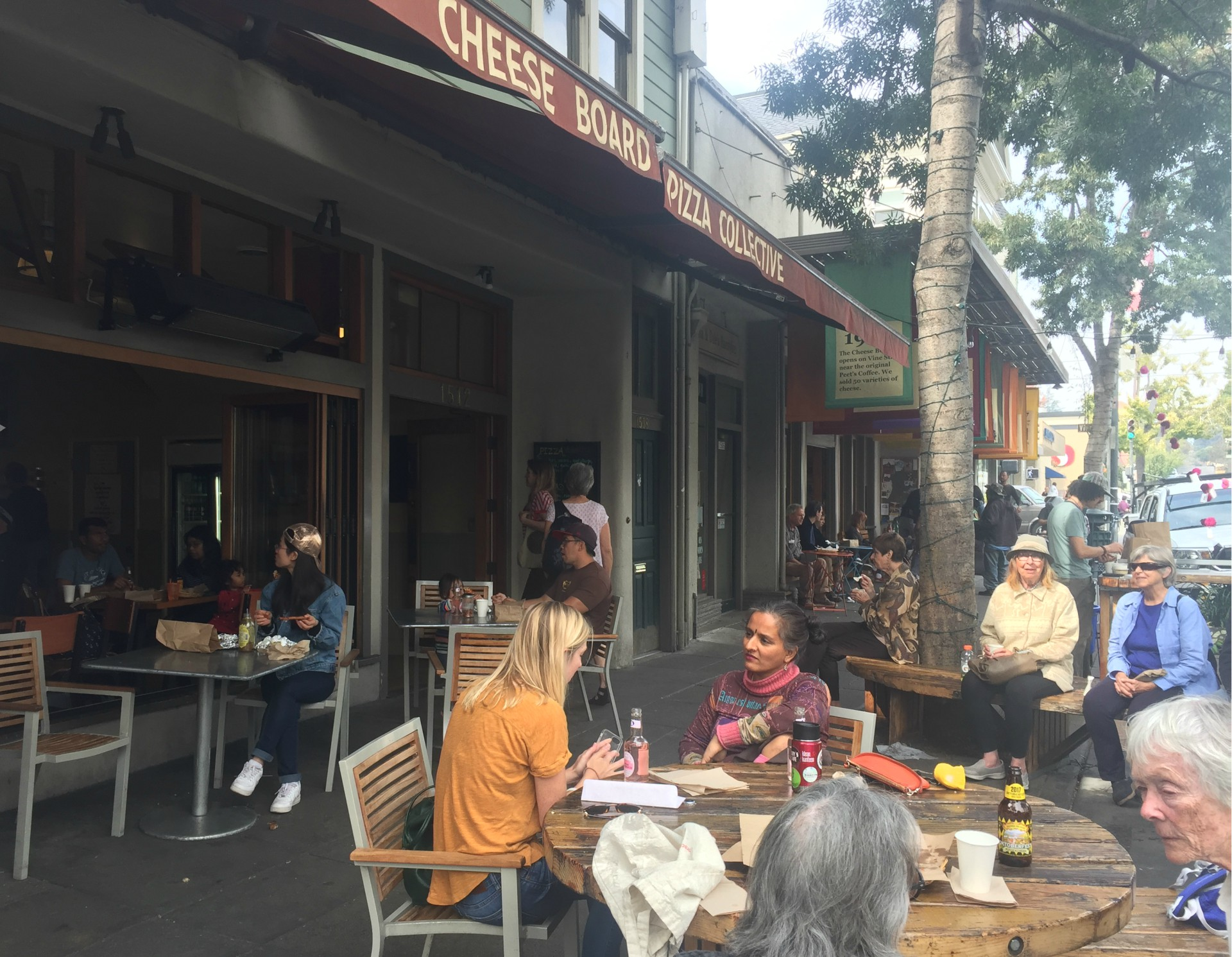 Customers enjoy a sunny afternoon at Cheeseboard in North Berkeley.