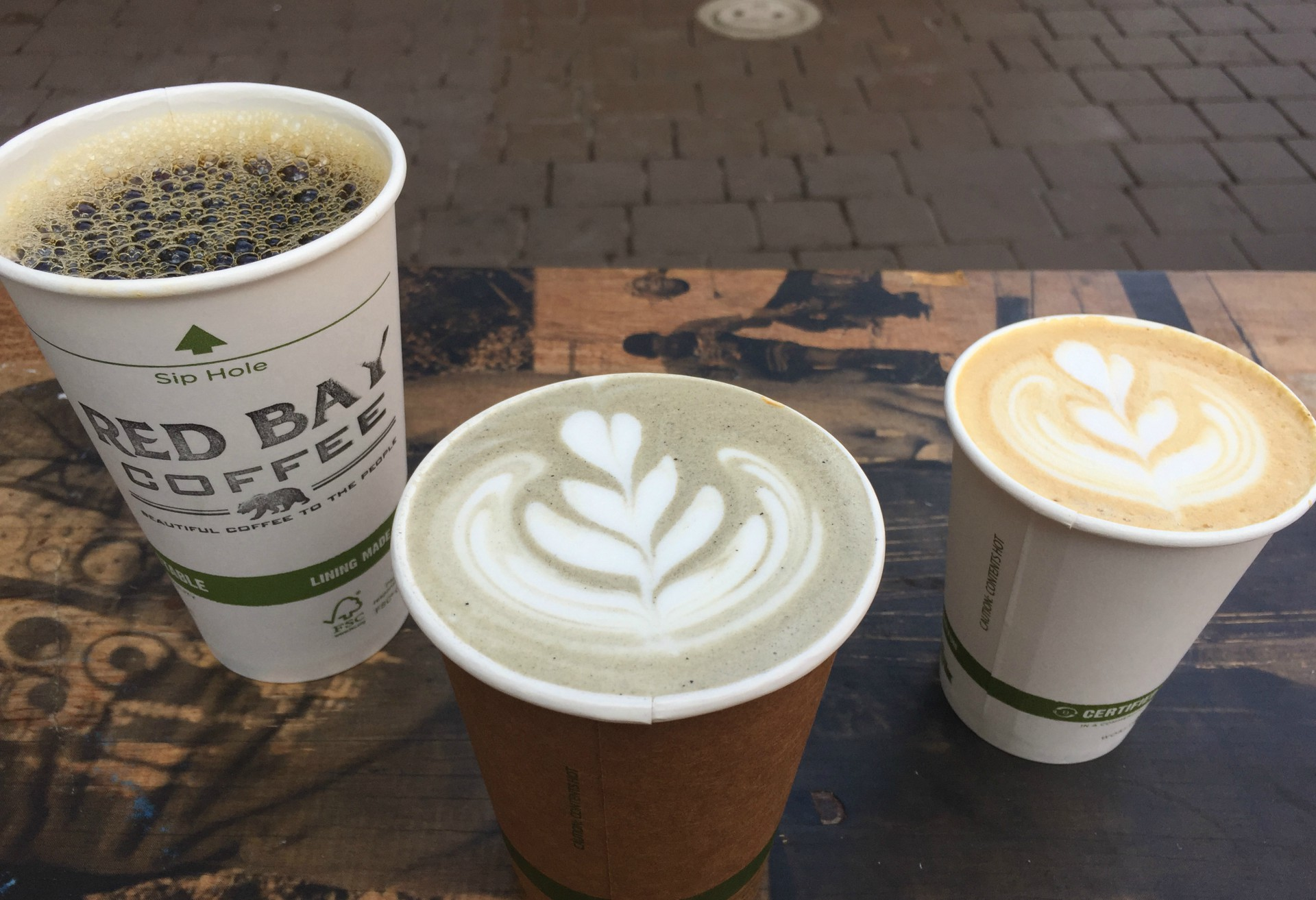Red Bay offers intriguing drinks like a charcoal vanilla latte and a honey lavender cappuccino in addition to their drip coffee.