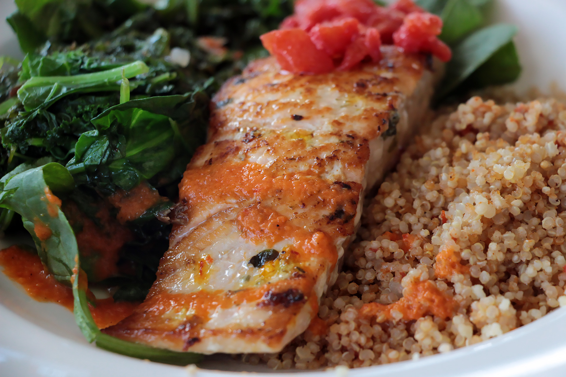 Wild salmon comes simply with quinoa and cooked spinach.