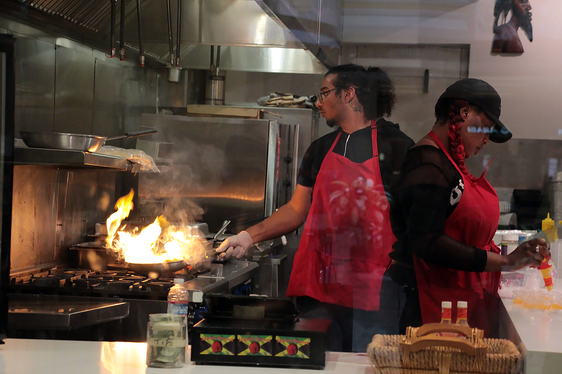 Staff preparing food at Scotch Bonnet.