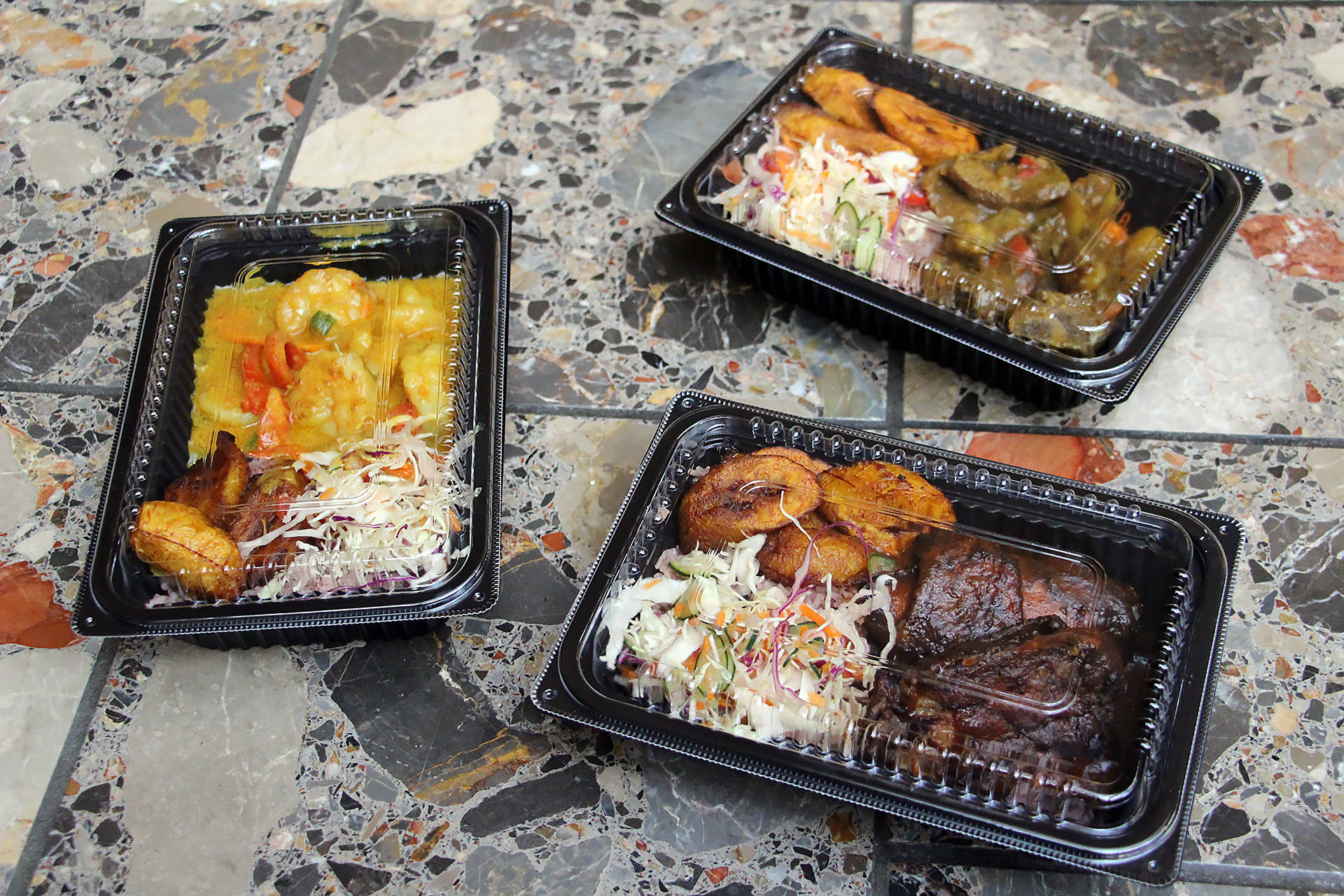 Curry Shrimp, Curry Goat and Jerk Chicken from Scotch Bonnet.