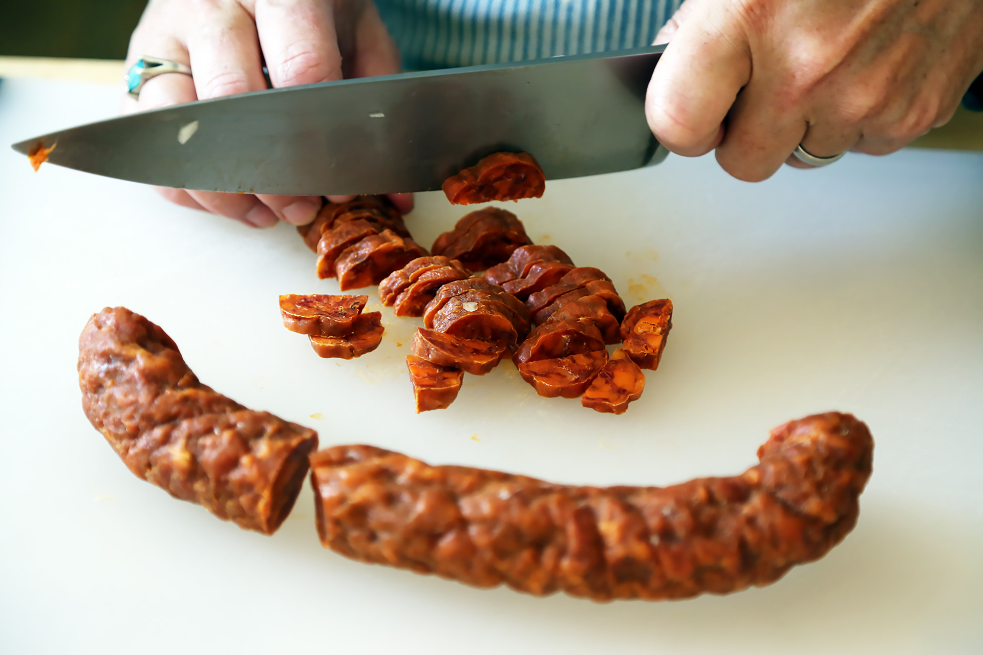 Prep 1/4 lb Spanish chorizo, halved or quartered lengthwise and sliced.