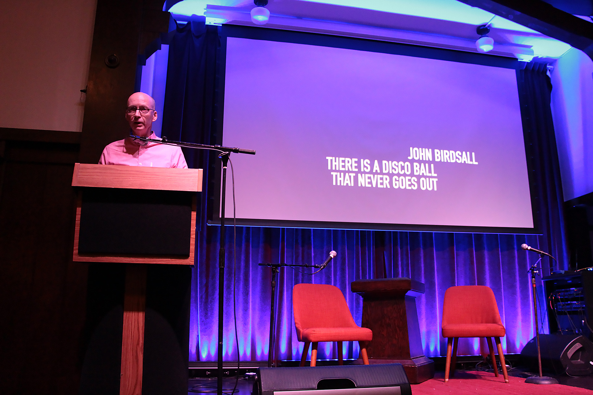 John Birdsall, an award-winning local writer, delivered a history lesson interwoven with personal travel tales exploring the refuge of queer safe spaces that exist around the world.