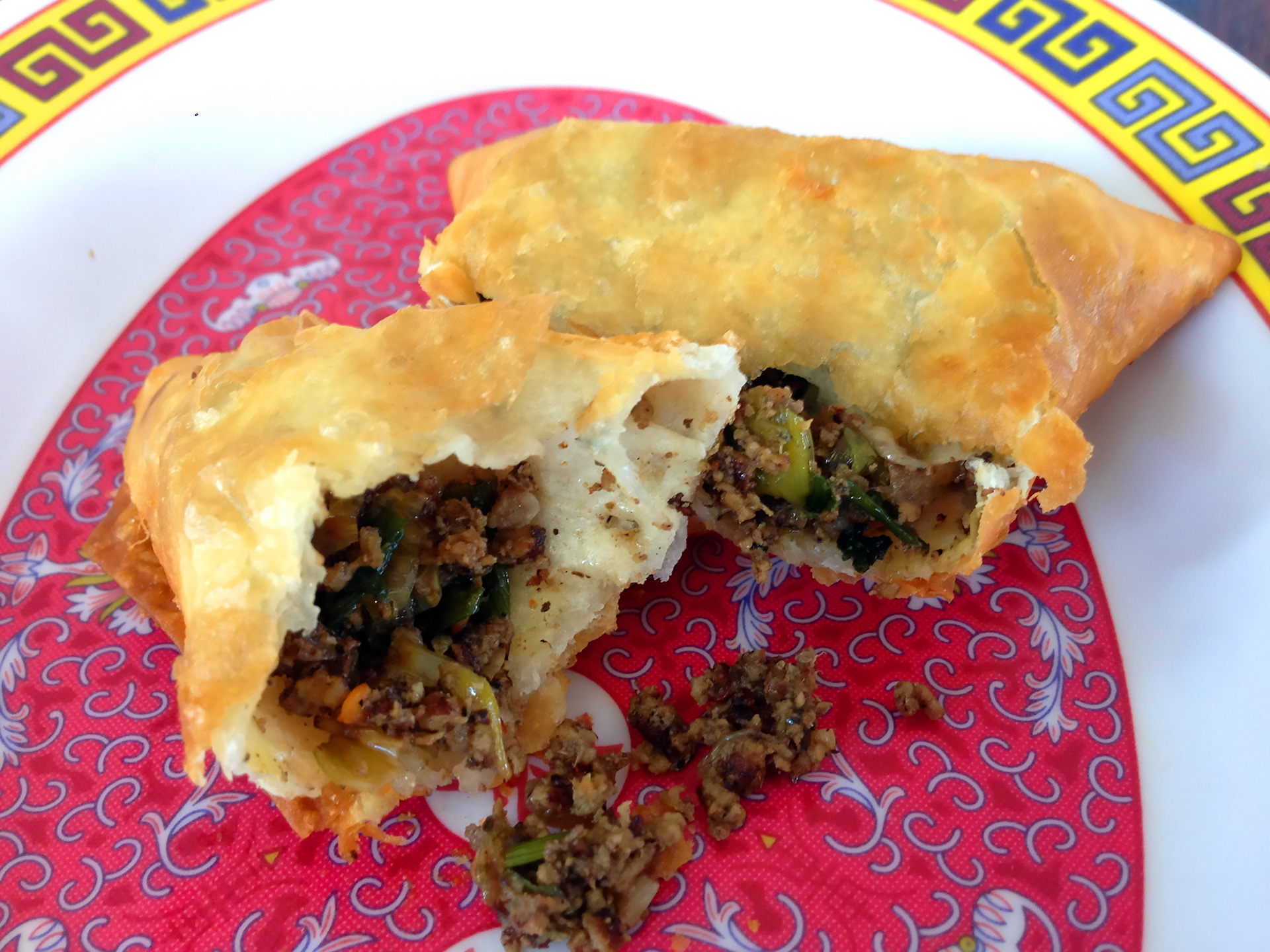 The ground beef filling of the sambusa.