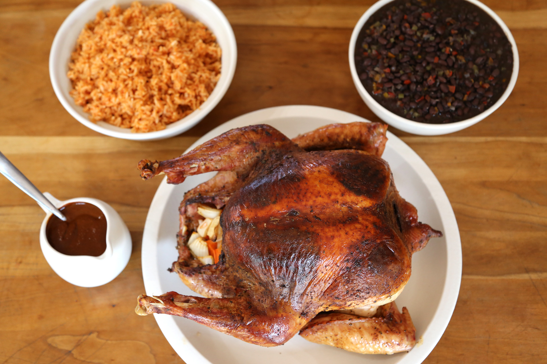 Chile-Rubbed Roast Turkey served with Savory Black Beans, Mexican Rice and Mole Gravy.
