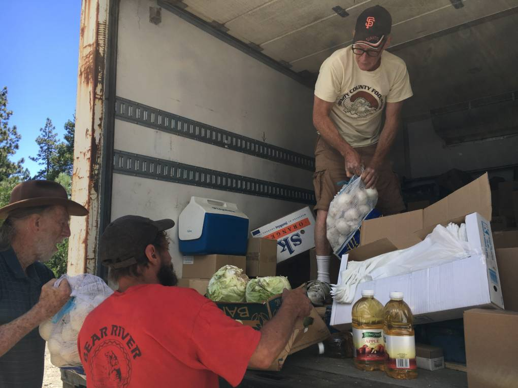 Jeff England, director of the Trinity County Food Bank, delivers items in remote Zenia, Calif. The closest large grocery store is 100 miles away.
