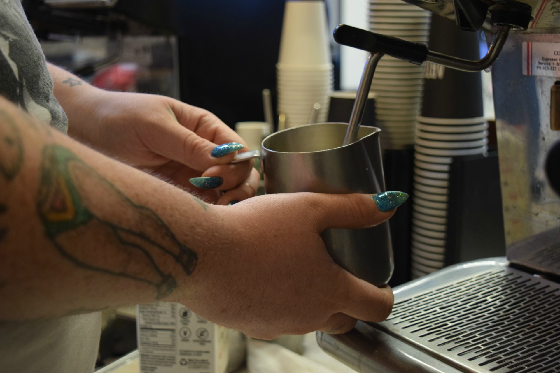To make the latte, barista Alexis Williams steams milk with a housemade pumpkin syrup.