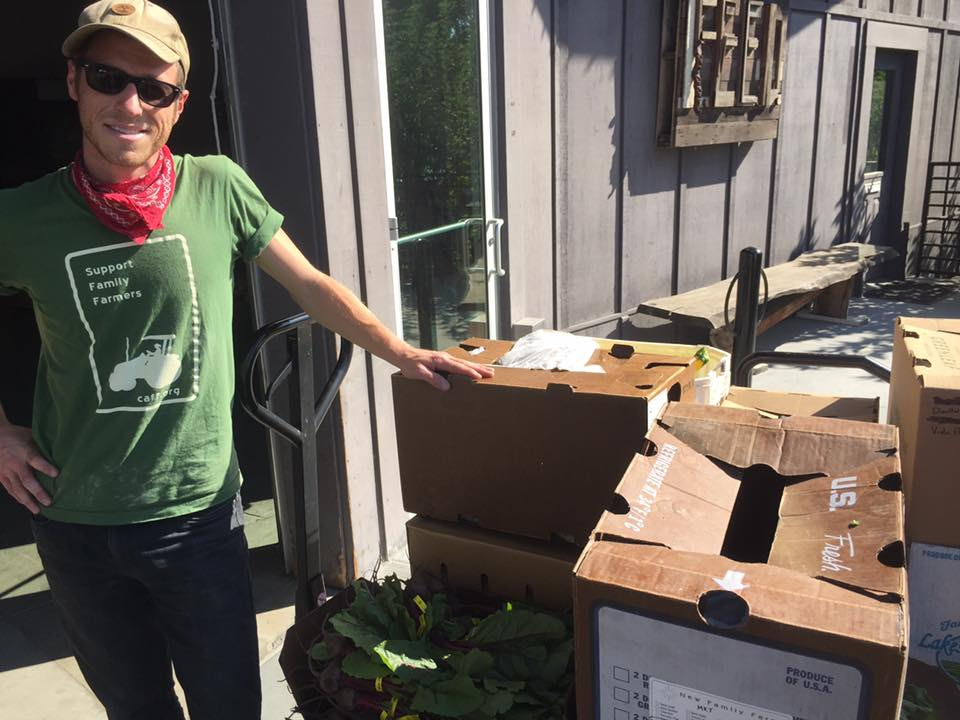 Evan Wiig of The Farmers Guild with produce donations at FEED Sonoma.