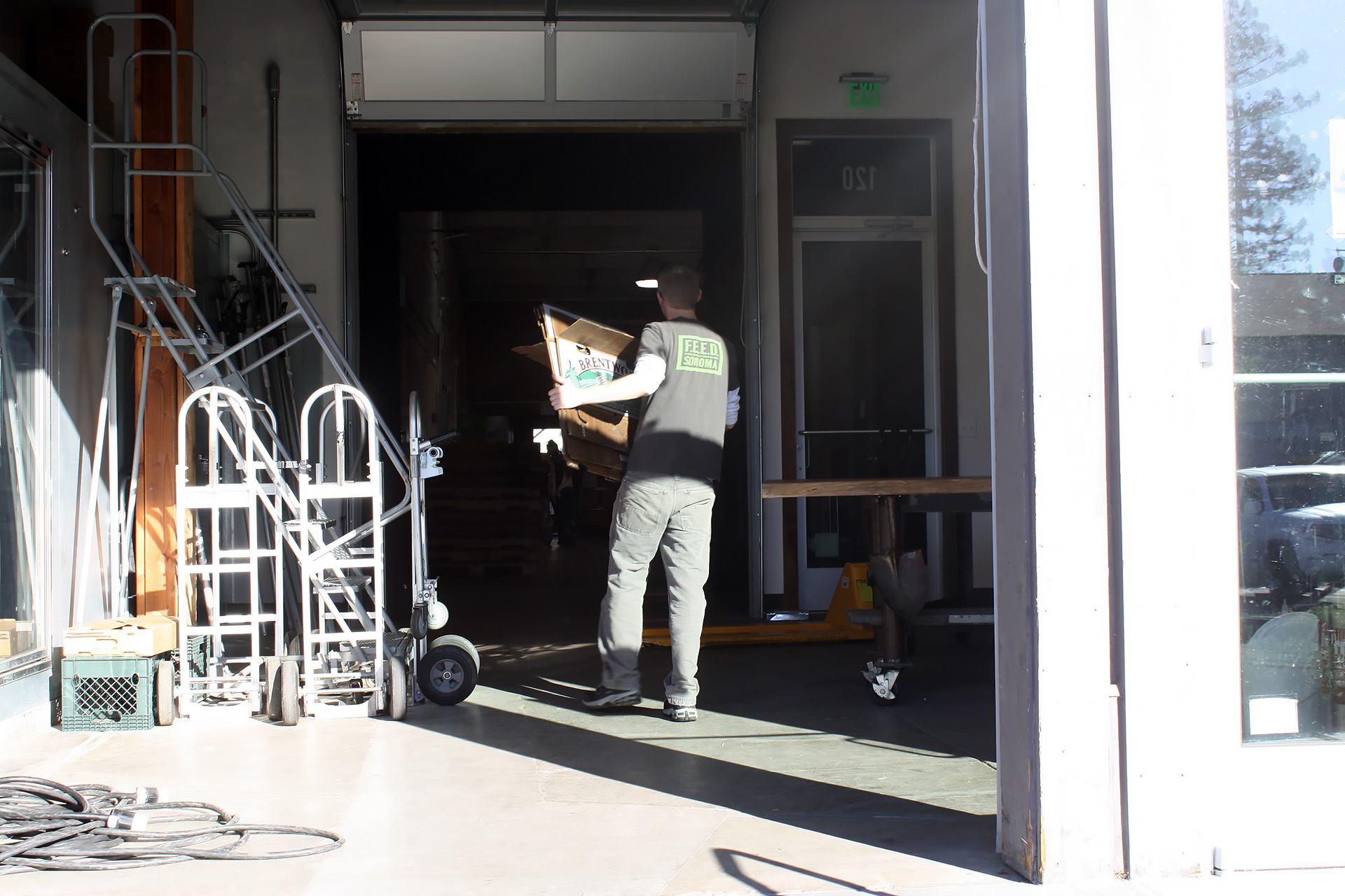 An employee carries produce to F.E.E.D. Sonoma's storage area.