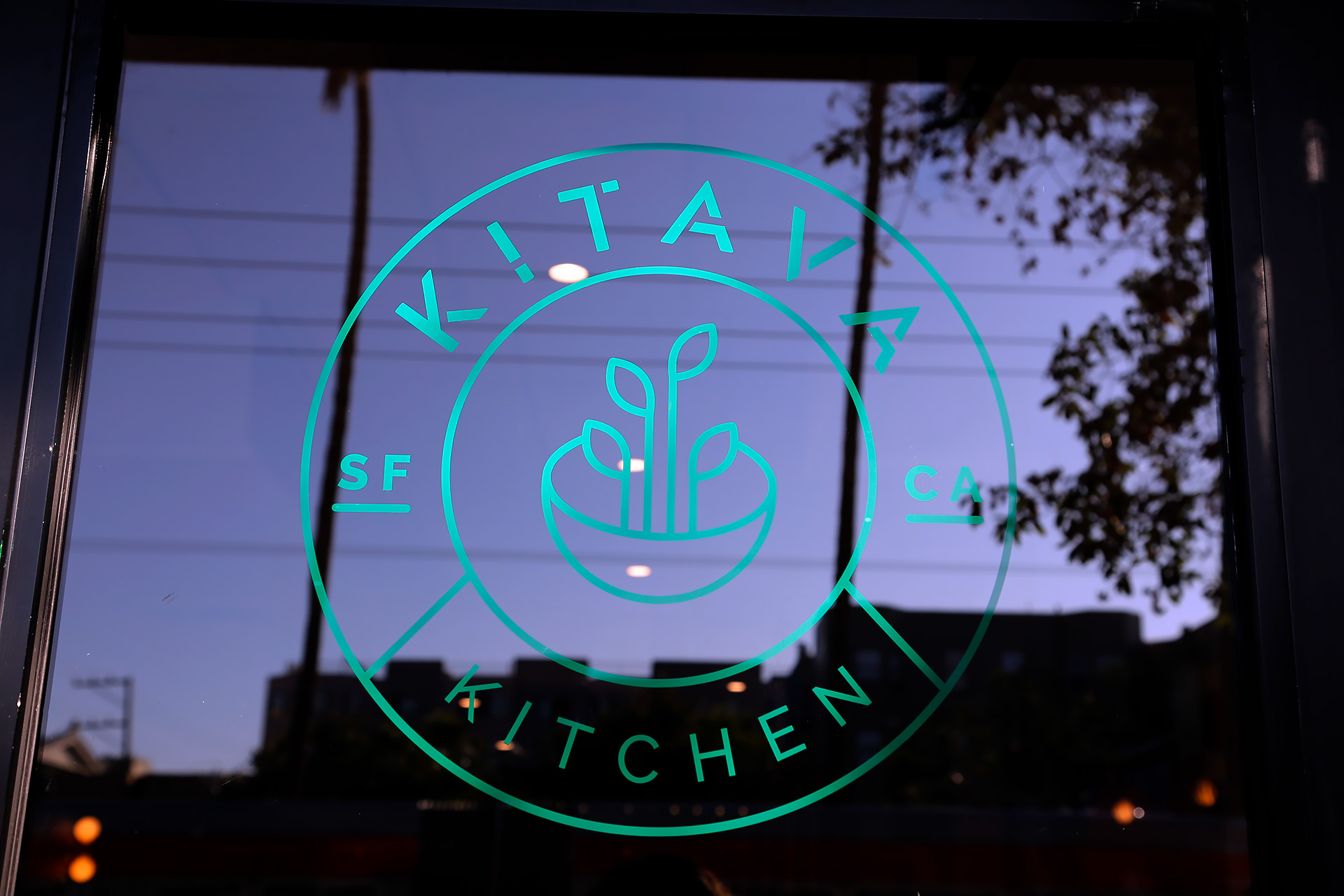 Kitava Kitchen logo on the doorway at Mission and 16th.