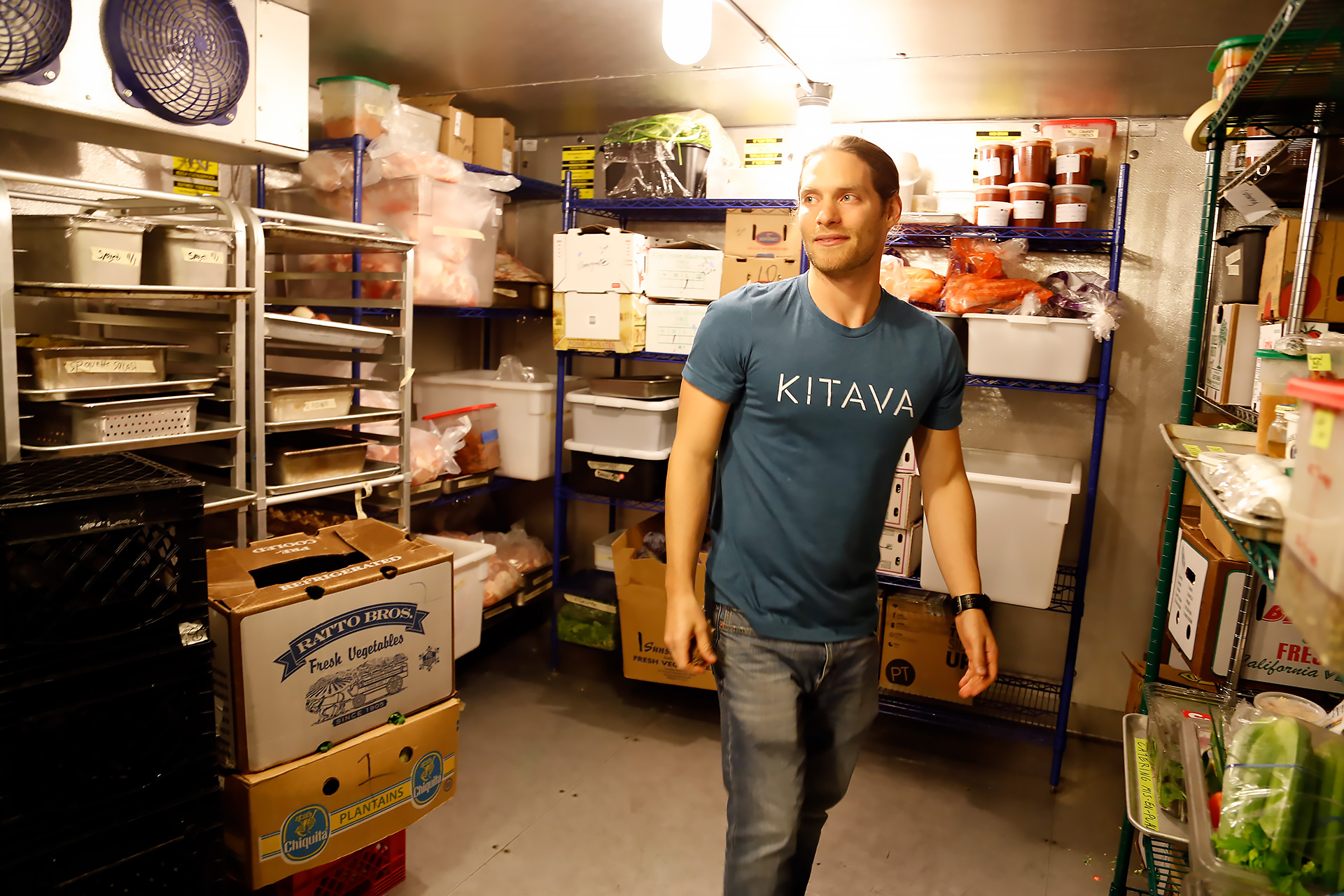 Bryan Tublin shows off the large walk-in cold storage space.