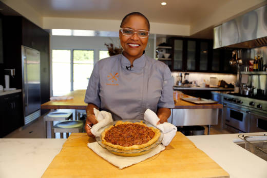 Tanya Holland serving up her freshly baked Chocolate Bourbon Pecan Pie.