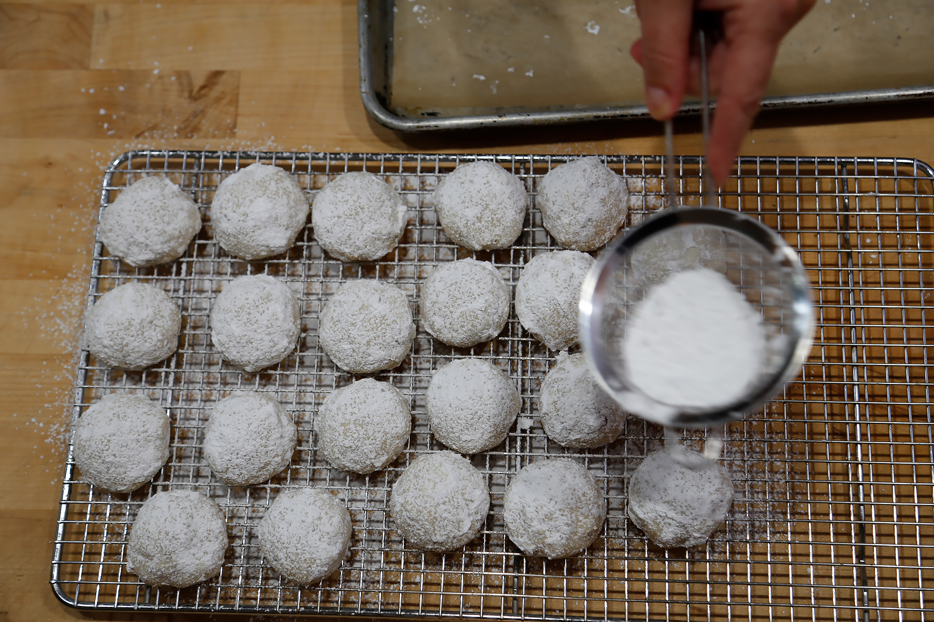 Transfer cookies to a wire rack to cool completely. If you like, dust the cookies with additional powdered sugar.