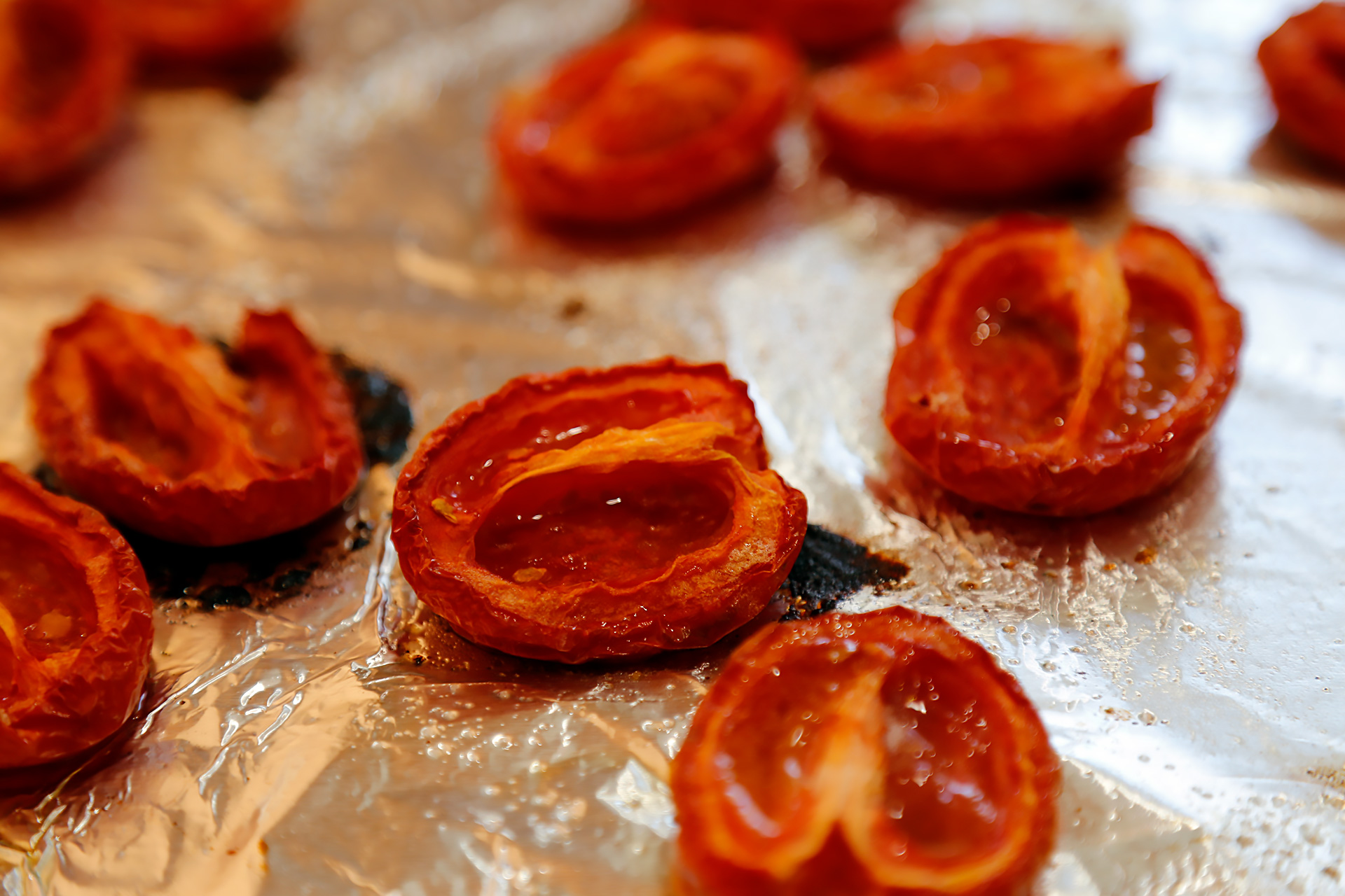 Roast the tomatoes until slightly shrunken and they begin to caramelize. Set aside to cool.