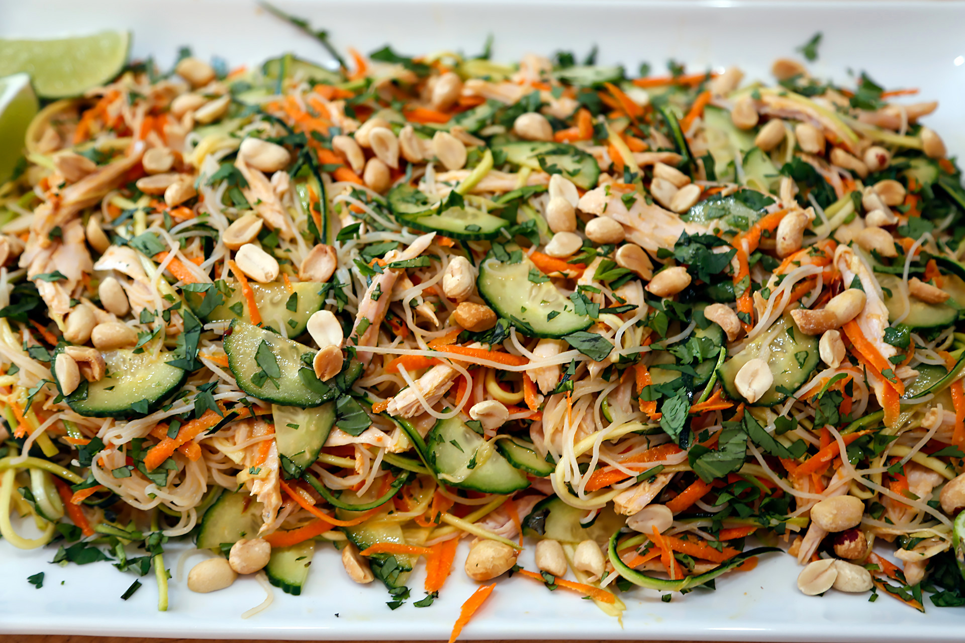 Asian-Style Noodle Salad with Turkey, Veggies, Herbs, and Lime-Peanut Vinaigrette.