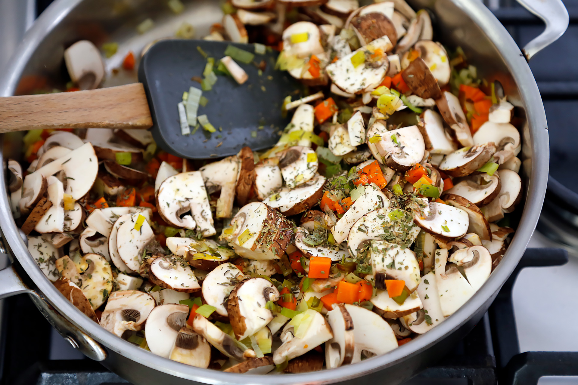 Add the mushrooms and thyme and cook, stirring, until tender, about 4 minutes.