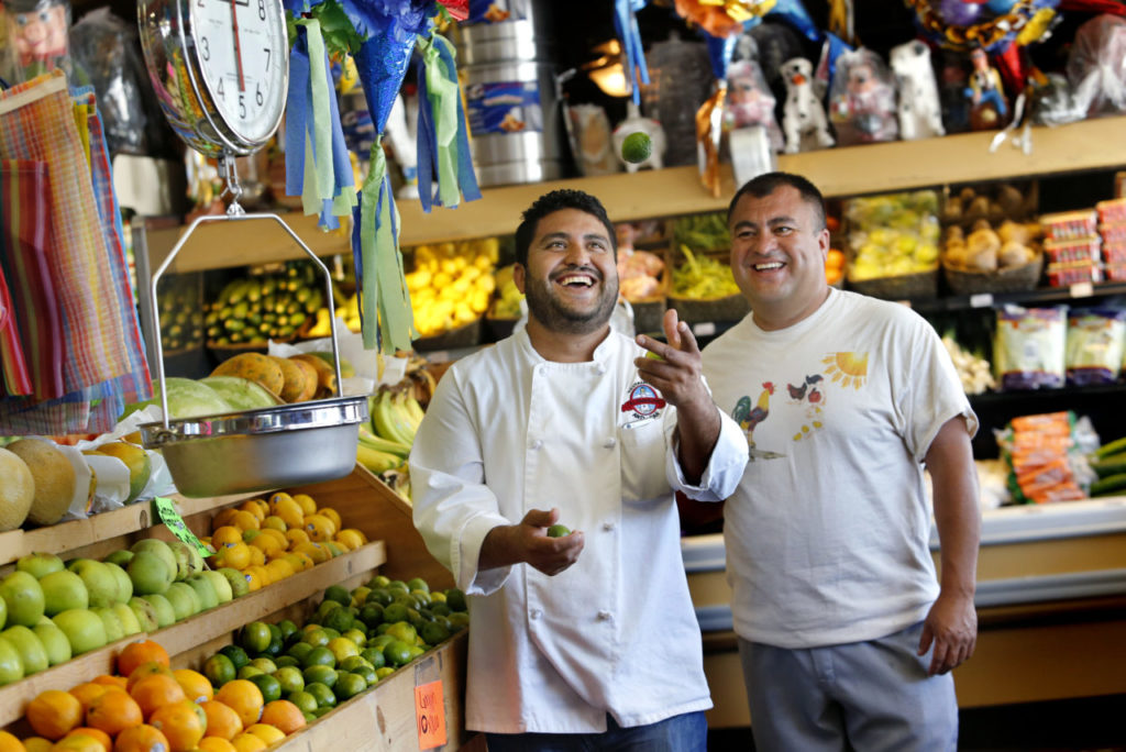 In this photo, Brothers Pedro, left, and Octavio Diaz at their store Casa del Mole Mercado and Carniceria.