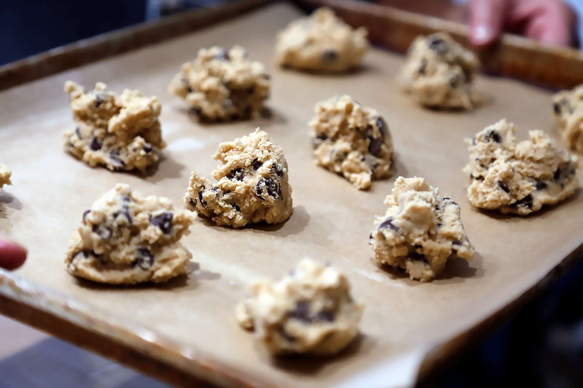 Drop the dough by heaping tablespoonfuls onto the baking sheet, spacing them evenly.