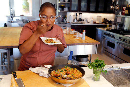 Tanya Holland tasting the Vegetarian Dirty Rice