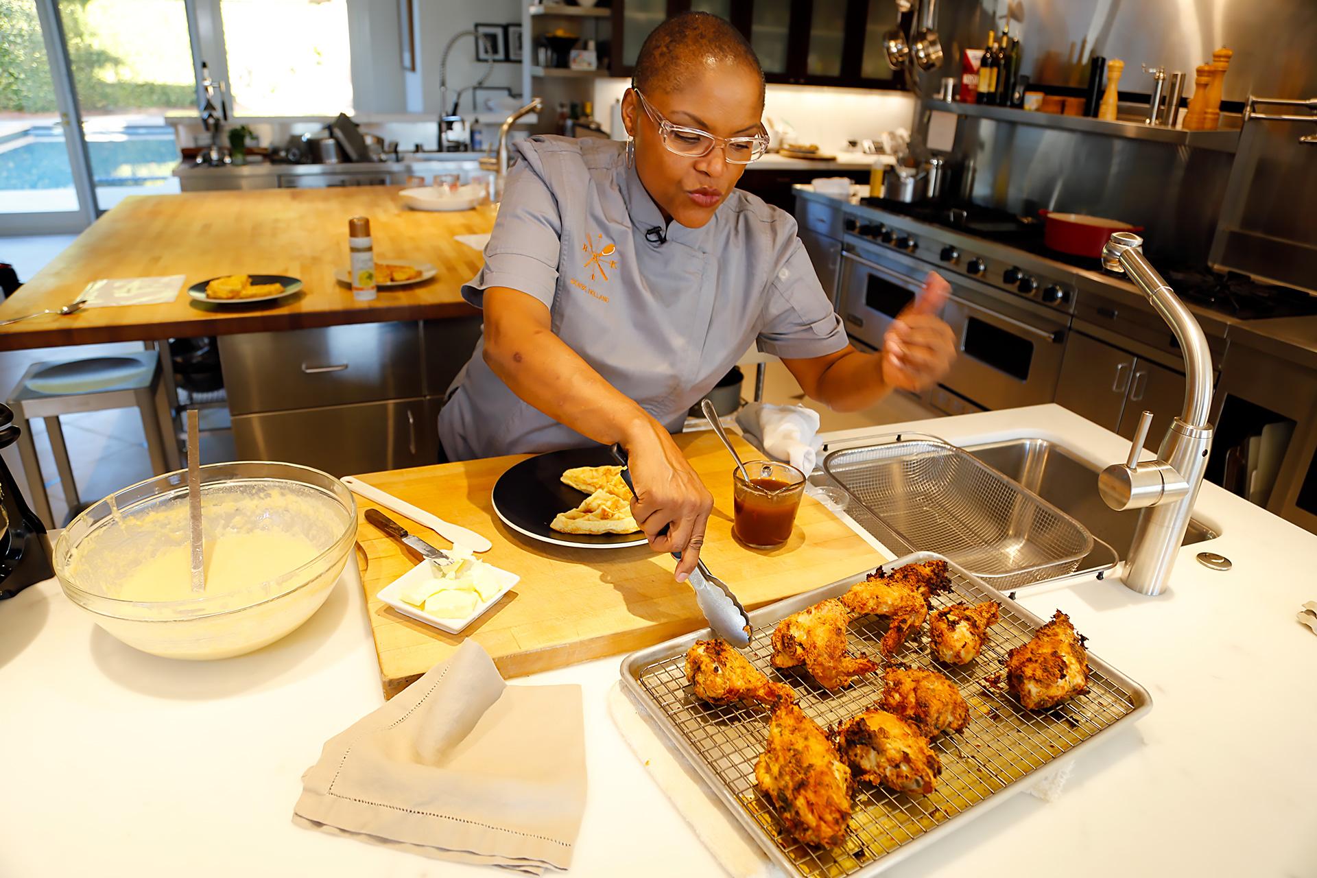 Tanya Holland making Brown Sugar Kitchen's  Buttermilk Fried Chicken to accompany Cornmeal Waffles.