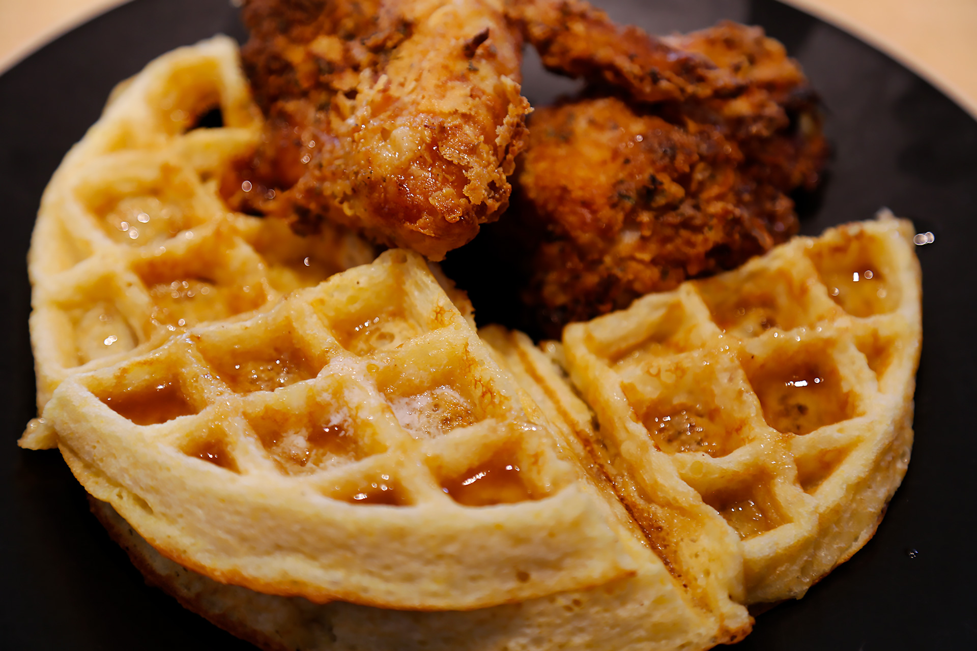 Serve cornmeal waffles with apple cider syrup and buttermilk fried chicken