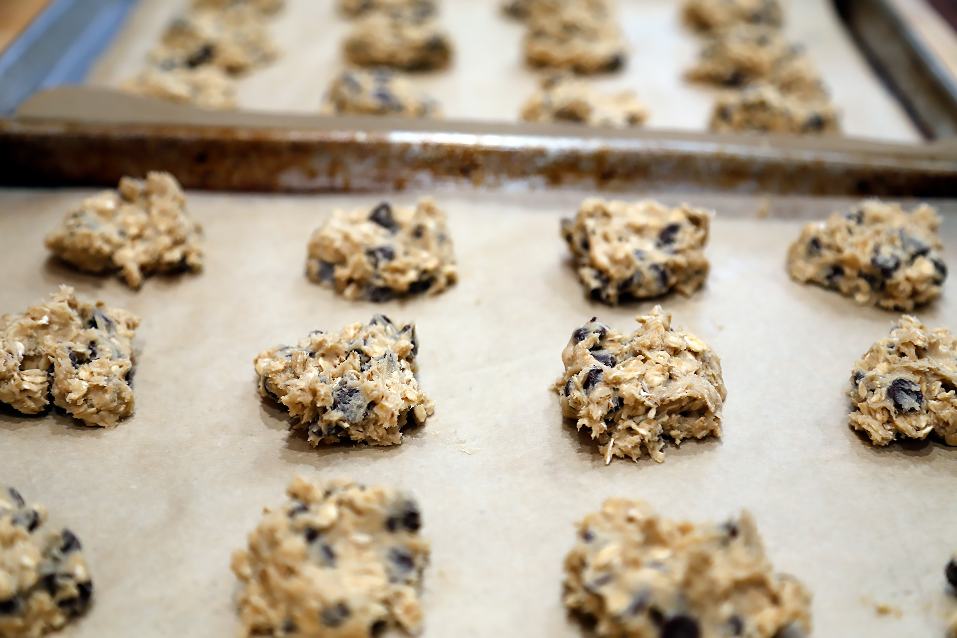 Drop rounded tablespoonfuls of the dough onto the prepared baking sheets, spacing them about an inch apart.